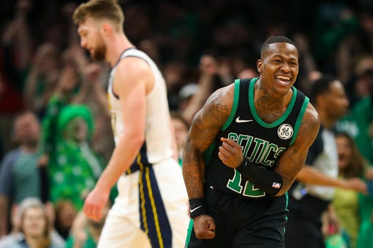 BOSTON, MA - APRIL 14:  Terry Rozier #12 of the Boston Celtics reacts after making a shot as time expires in ethics's third quarter during Game One of the first round of the 2019 NBA Eastern Conference Playoffs against the Indiana Pacers at TD Garden on April 14, 2019 in Boston, Massachusetts. NOTE TO USER: User expressly acknowledges and agrees that, by downloading and or using this photograph, User is consenting to the terms and conditions of the Getty Images License Agreement. (Photo by Adam Glanzman/Getty Images)
