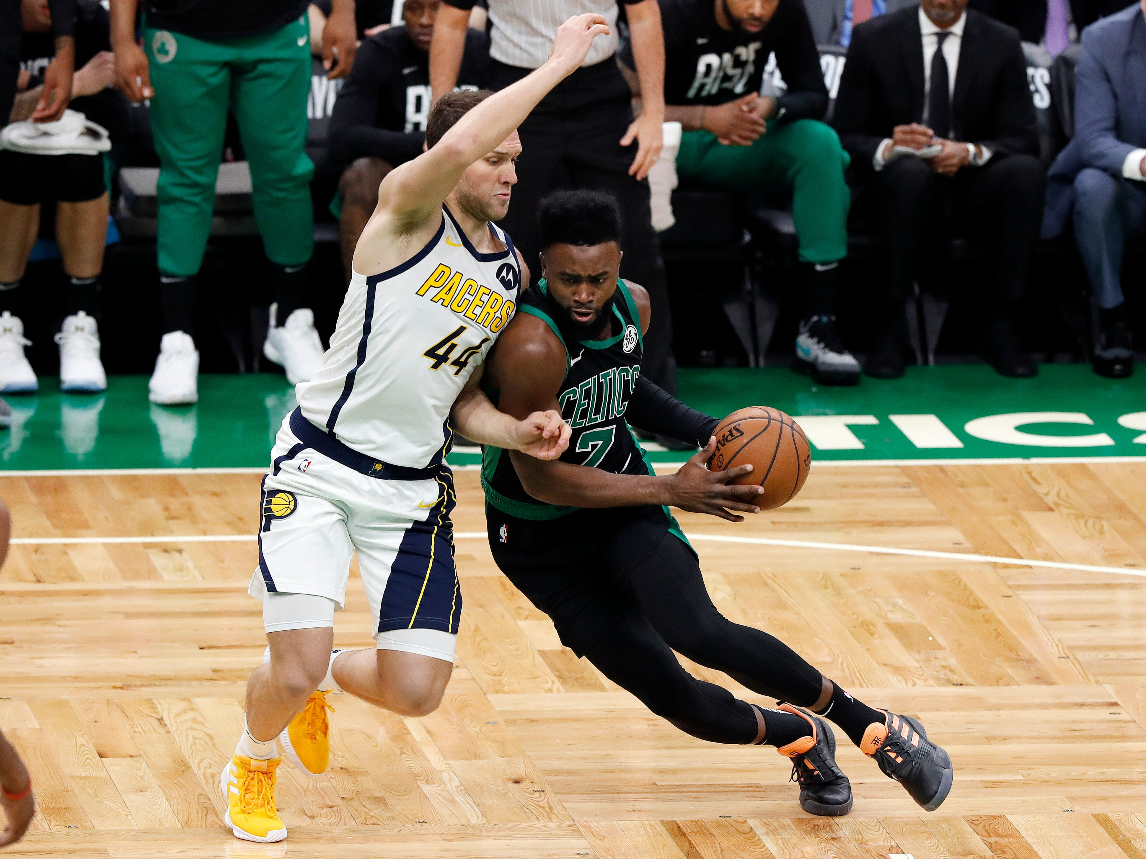 Boston Celtics' Jaylen Brown drives on Indiana Pacers' Bojan Bogdanovic during the first quarter in Game 1 of a first-round NBA basketball playoff series, Sunday, April 14, 2019, in Boston.
