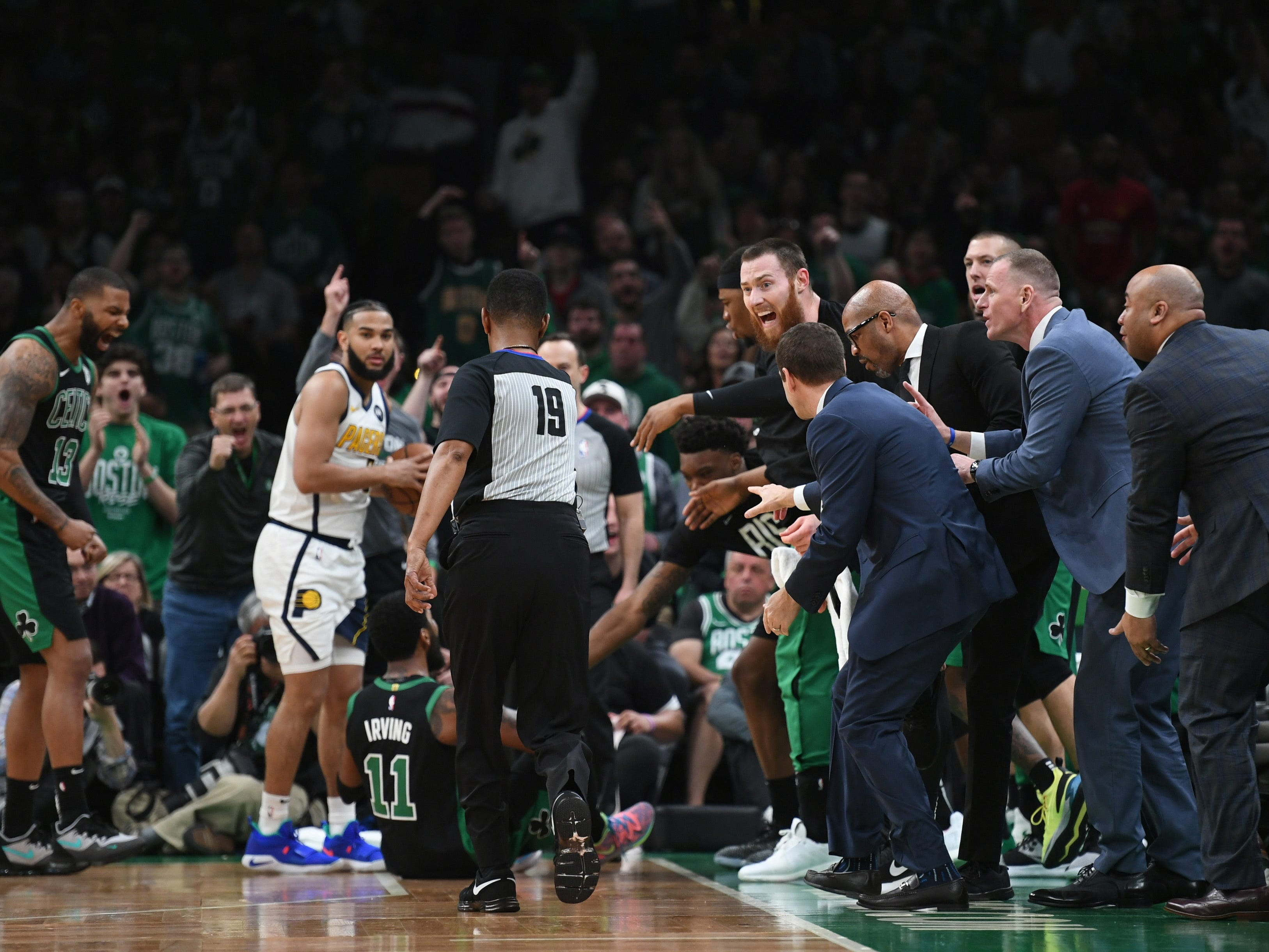 Apr 14, 2019; Boston, MA, USA; Boston Celtics center Aron Baynes (46) and the bench argue an out of bounds call by the official during the second half in game one of the first round of the 2019 NBA Playoffs at TD Garden.