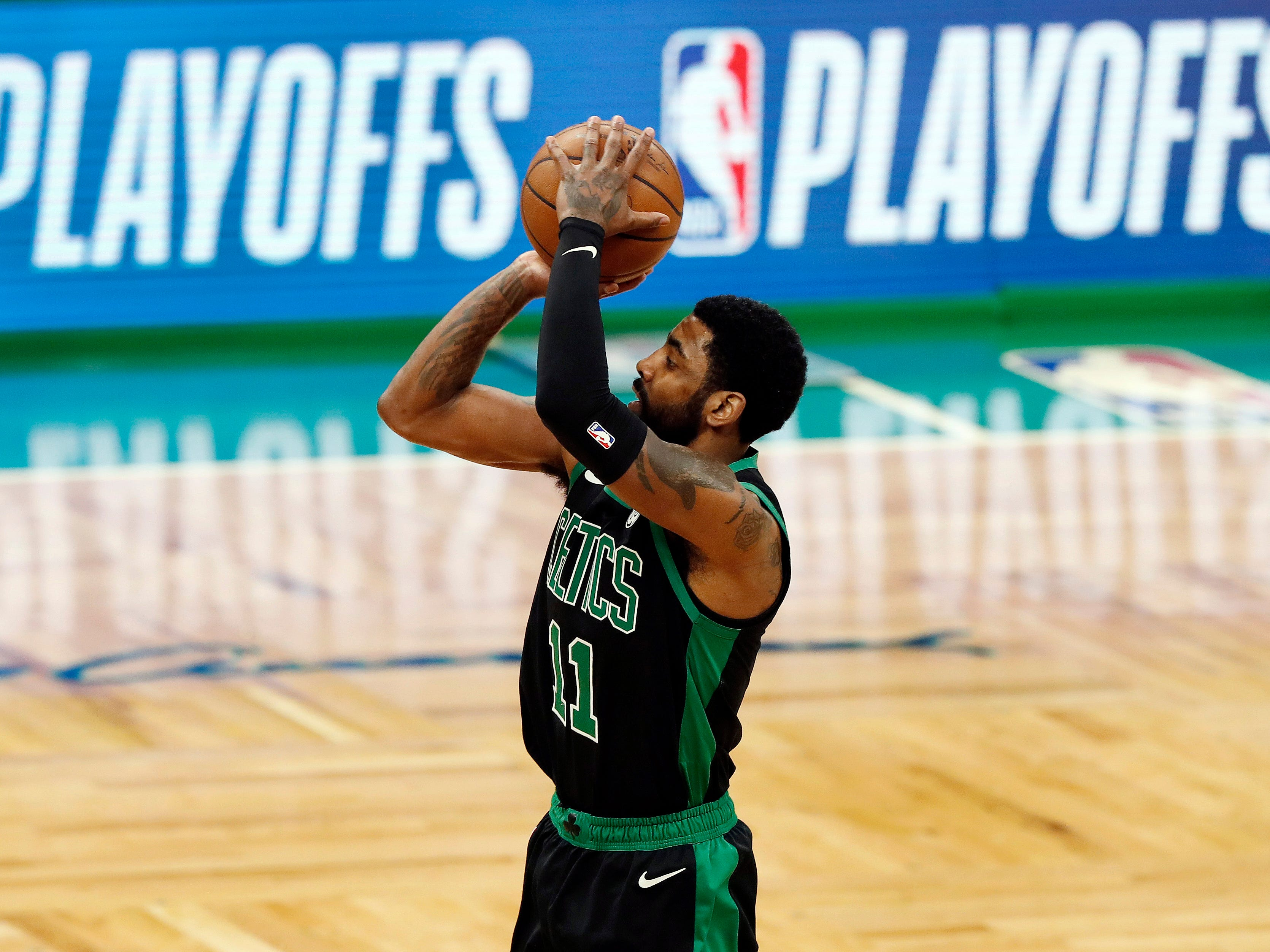 Boston Celtics' Kyrie Irving shoots against the Indiana Pacers during the first quarter in Game 1 of a first-round NBA basketball playoff series, Sunday, April 14, 2019, in Boston.