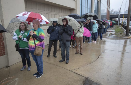 Several thousand people stand in a line during a rainstorm to attend a rally for Pete Buttigieg, Mayor of South Bend, who is expected to announce that he is running for U.S. President, South Bend, Sunday, April 14, 2019.