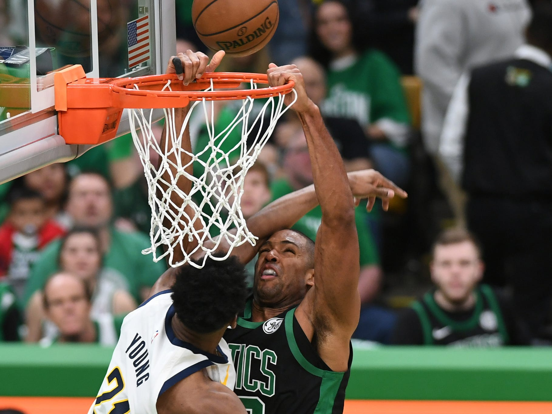 Apr 14, 2019; Boston, MA, USA; Boston Celtics center Al Horford (42) misses a dunk while Indiana Pacers forward Thaddeus Young (21) defends during the first half in game one of the first round of the 2019 NBA Playoffs at TD Garden.