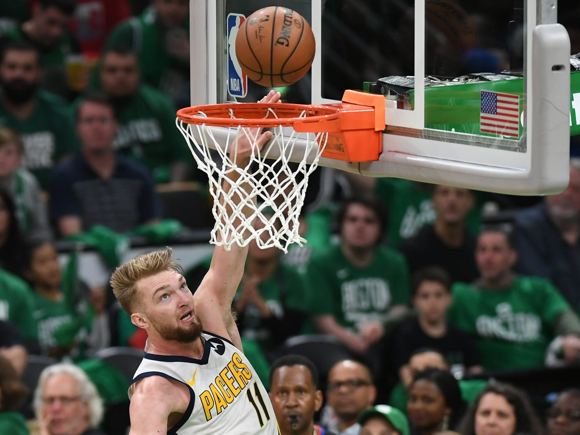 Apr 14, 2019; Boston, MA, USA; Indiana Pacers forward Domantas Sabonis (11) lays the ball in the basket during the first half in game one of the first round of the 2019 NBA Playoffs against the Boston Celtics at TD Garden.