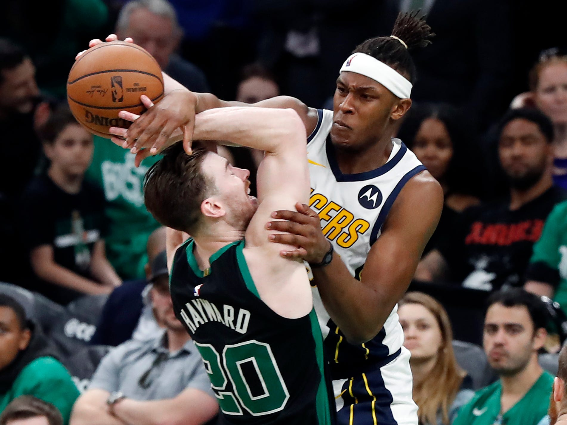 Indiana Pacers' Myles Turner, right, fouls Boston Celtics' Gordon Hayward as he goes to shoot during the fourth quarter in Game 1 of a first-round NBA basketball playoff series, Sunday, April 14, 2019, in Boston. (AP Photo/Winslow Townson)