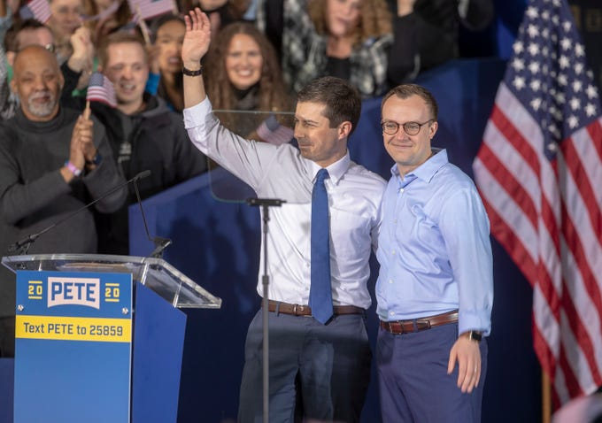 Pete Buttigieg, Democratic presidential candidate, stands with his husband, Chasten (right), after he announced in  South Bend on Sunday, April 14, 2019, that he is officially running.