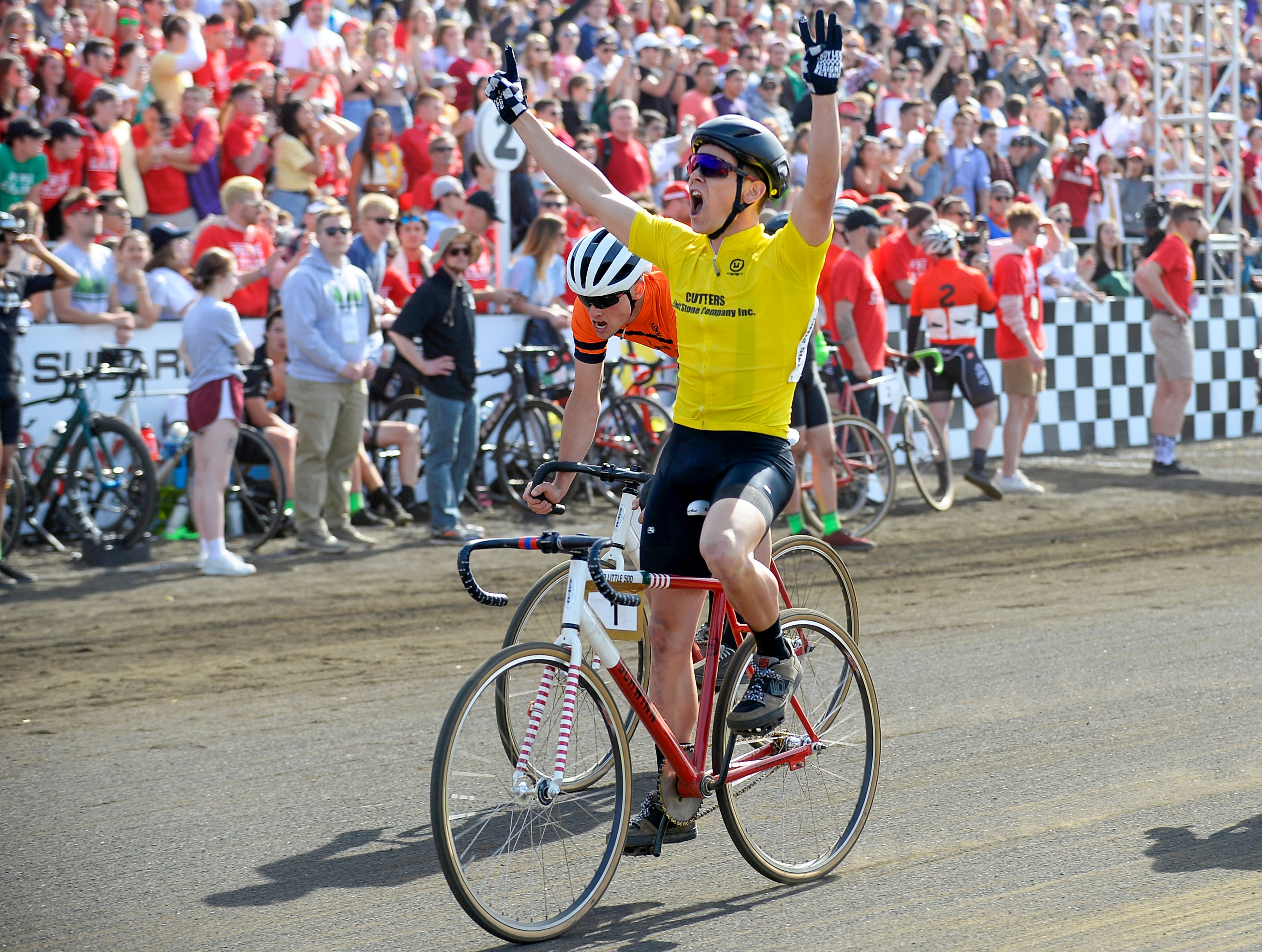 Noble Guyon of Cutters celebrates after crossing the finish line to win the men's Little 500 at Bill Armstrong Stadium in Bloomington, Ind., on Saturday, April 13, 2019.