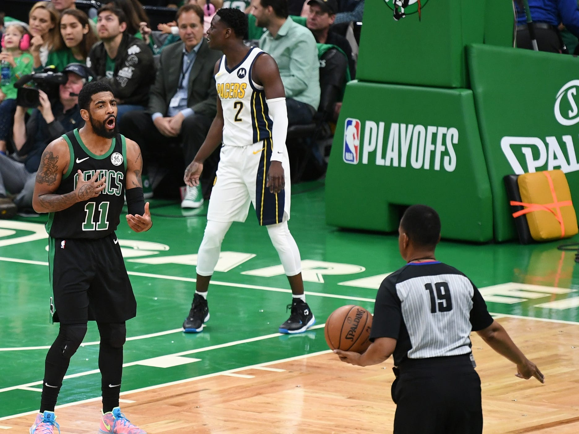 Apr 14, 2019; Boston, MA, USA; Boston Celtics guard Kyrie Irving (11) questions a foul to the official during the first half in game one of the first round of the 2019 NBA Playoffs against the Indiana Pacers at TD Garden.