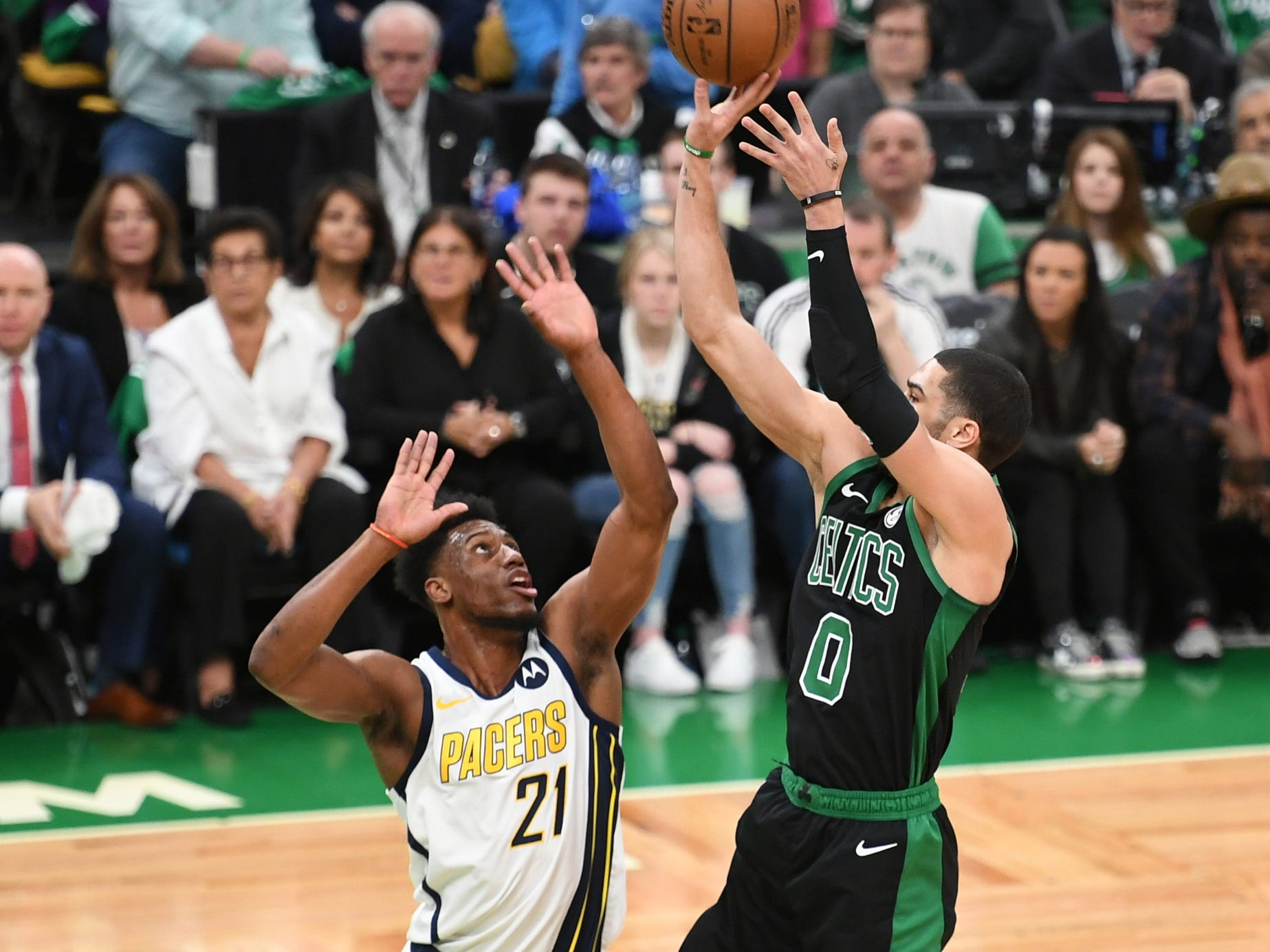 Apr 14, 2019; Boston, MA, USA; Boston Celtics forward Jayson Tatum (0) shoots the ball over Indiana Pacers forward Thaddeus Young (21) during the first half in game one of the first round of the 2019 NBA Playoffs at TD Garden.