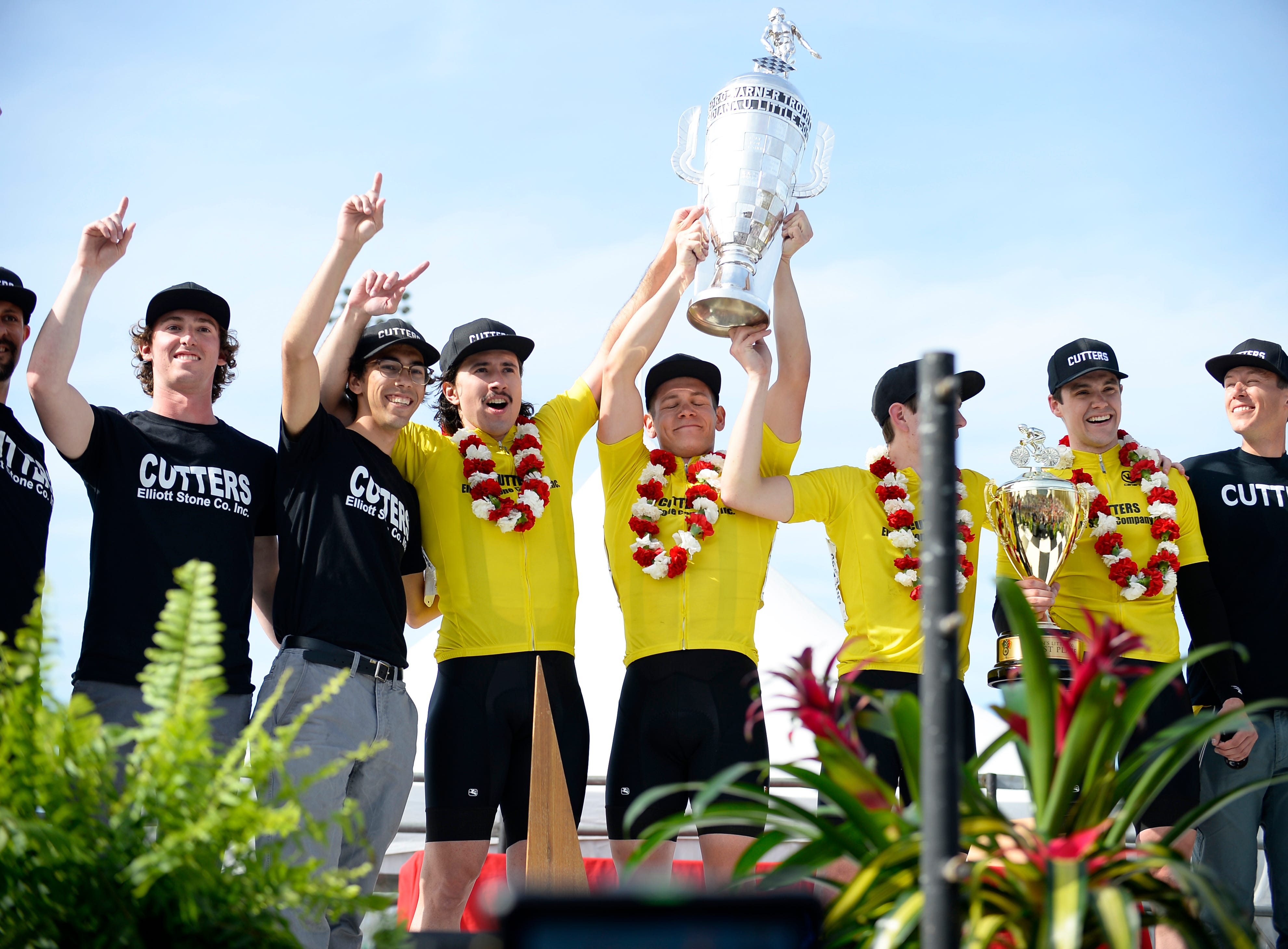 The Cutters hold up the Borg Warner Trophy after winning the men's Little 500 at Bill Armstrong Stadium in Bloomington, Ind., on Saturday, April 13, 2019.