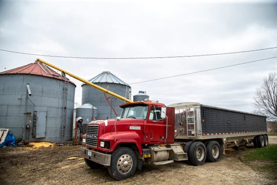 Allan Graham's Mack semi trailer sits next to a grain bin on Friday, April 12, 2019, at their farm in Poweshiek County, Iowa. The Graham family farms soybeans and corn in addition to raising hogs.
