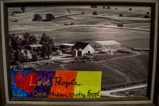 An aerial photo of the Graham farm hangs in the kitchen on Friday, April 12, 2019, at their home in Poweshiek County, Iowa. The Graham family has operated their farm for 140 years.