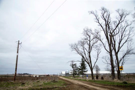 A hog confinement building operated by the The Graham family is seen from the road on Friday, April 12, 2019, in Poweshiek County, Iowa. The Graham family also farms soybeans and corn in addition to raising hogs.