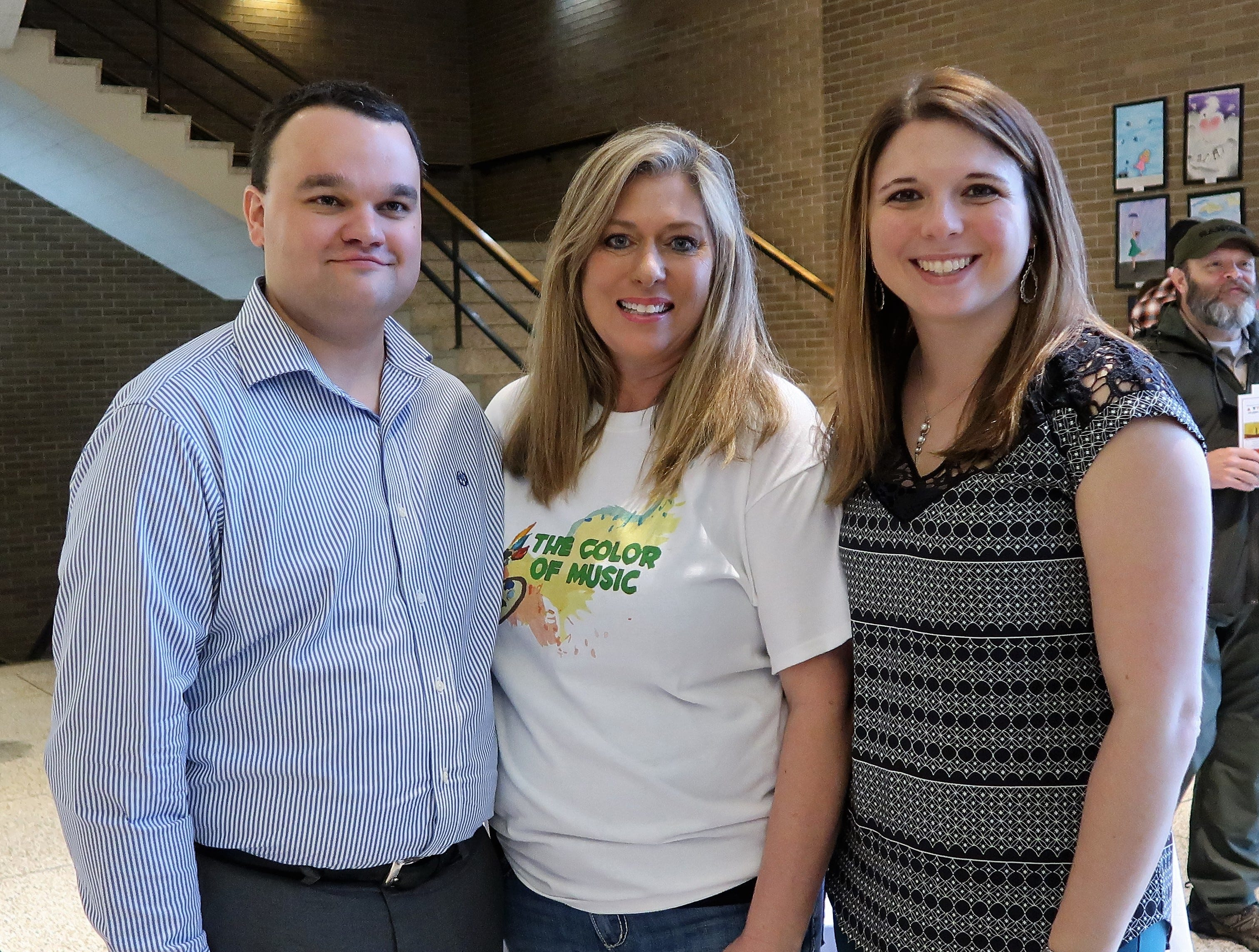 Jackson Symphony League President Elect Cody Blue Miller poses with event co-chair Chrisi Haynes and Jackson Symphony League Marketing Director Caitlin Roach at the 2019 Color of Music awards at the Carl Perkins Civic Center in Jackson on Saturday, April 13.