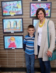 Gideon Musselman stands with his mother next to his drawing of an abstract three-arched structure at the 2019 Color of Music awards at the Carl Perkins Civic Center in Jackson on Saturday, April 13. Musselman won a blue ribbon award for his work.