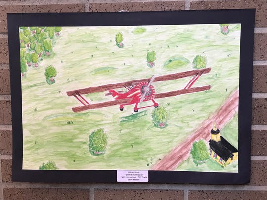 Seventh-grade student William Brady's artwork depicting a biplane soaring above a field won a blue ribbon award at the 2019 Color of Music awards at the Carl Perkins Civic Center in Jackson on Saturday, April 13.