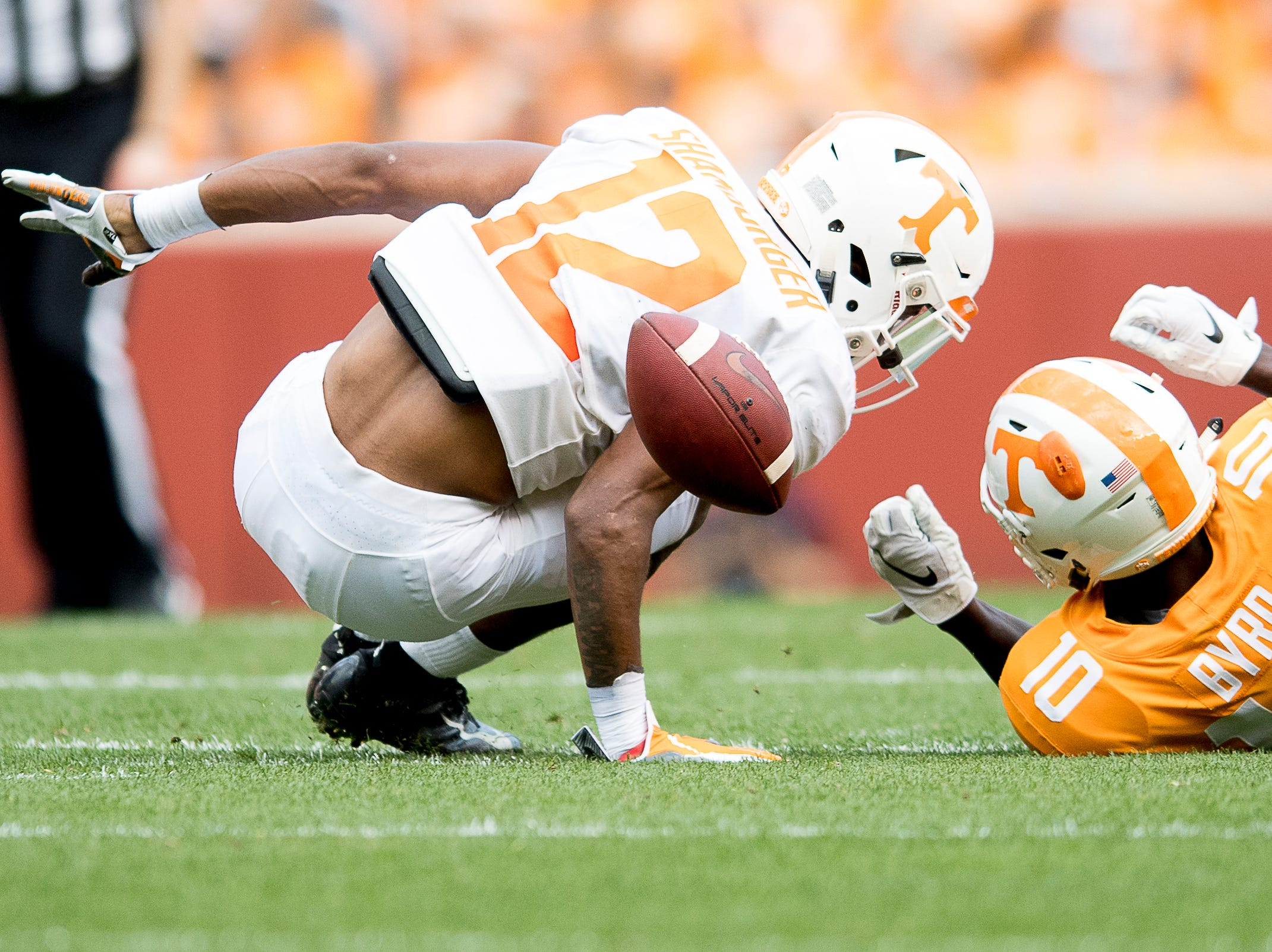 Tennessee defensive back Shawn Shamburger (12) loses the ball as Tennessee wide receiver Tyler Byrd (10) defends during the Tennessee Spring Game at Neyland Stadium in Knoxville, Tennessee on Saturday, April 13, 2019.