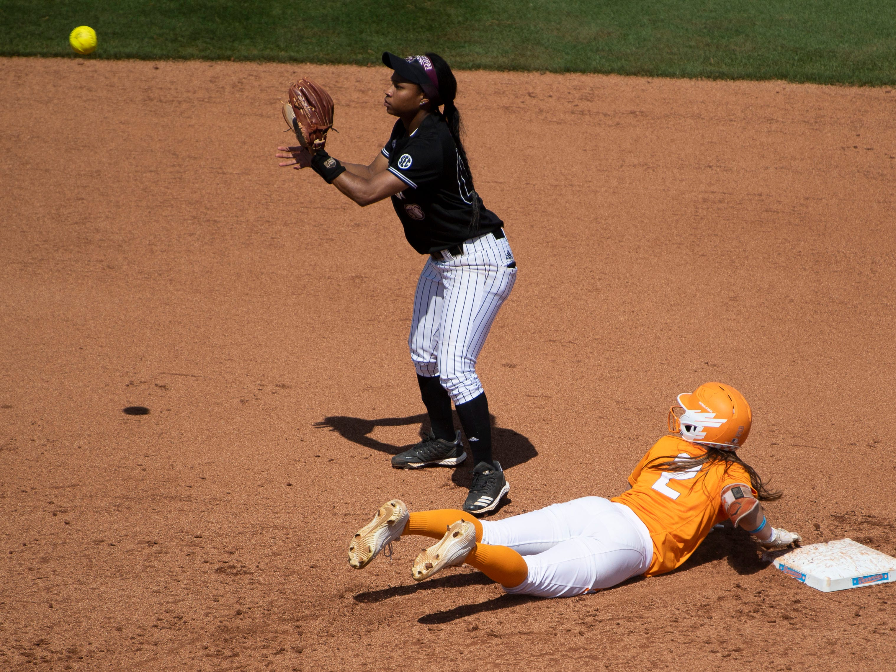 Tennessee's Jenna Holcomb (2) returns safely to second base under Mississippi State's Bevia Robinson (00) at Sherri Parker Lee Stadium on Sunday, April 14, 2019.