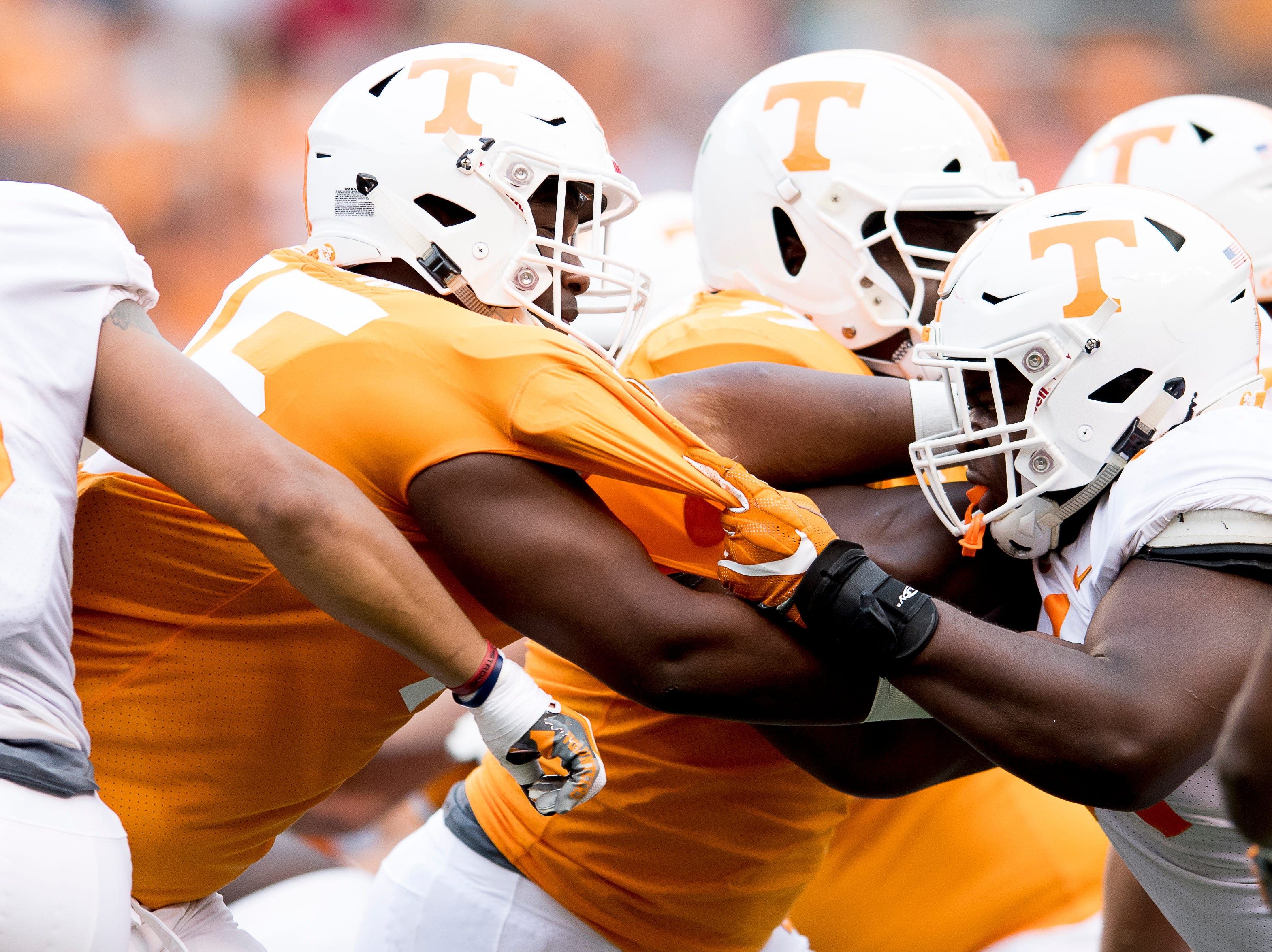 Tennessee offensive lineman Jerome Carvin (75) and Tennessee defensive lineman Kingston Harris (54) tackle one another during the Tennessee Spring Game at Neyland Stadium in Knoxville, Tennessee on Saturday, April 13, 2019.