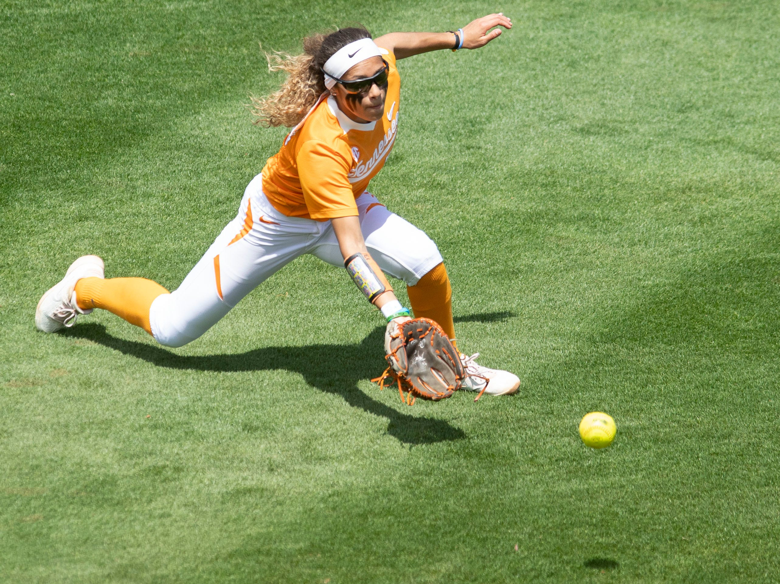 Tennessee's Amanda Ayala (13) runs towards a hit to left field in the game against Mississippi State at Sherri Parker Lee Stadium on Sunday, April 14, 2019.