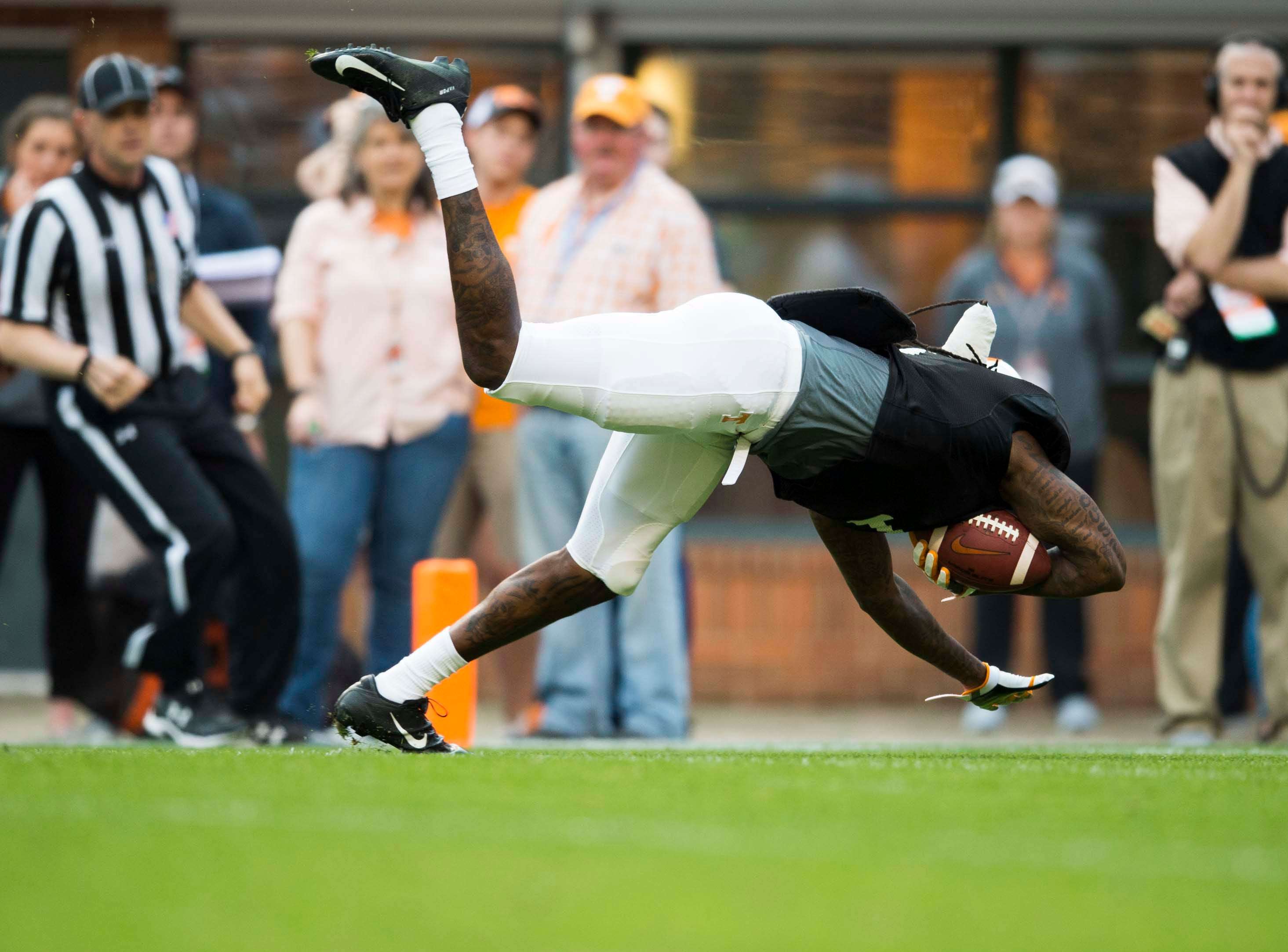 Tennessee wide receiver Marquez Callaway (1) dives into the end zone during the Vols spring game in Neyland Stadium in Knoxville Saturday, April 13, 2019.