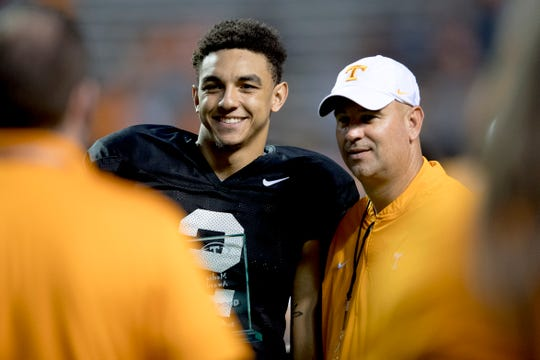 Tennessee quarterback Jarrett Guarantano (2) receives an award with Tennessee Head Coach Jeremy Pruitt during the Tennessee Spring Game at Neyland Stadium in Knoxville, Tennessee on Saturday, April 13, 2019.