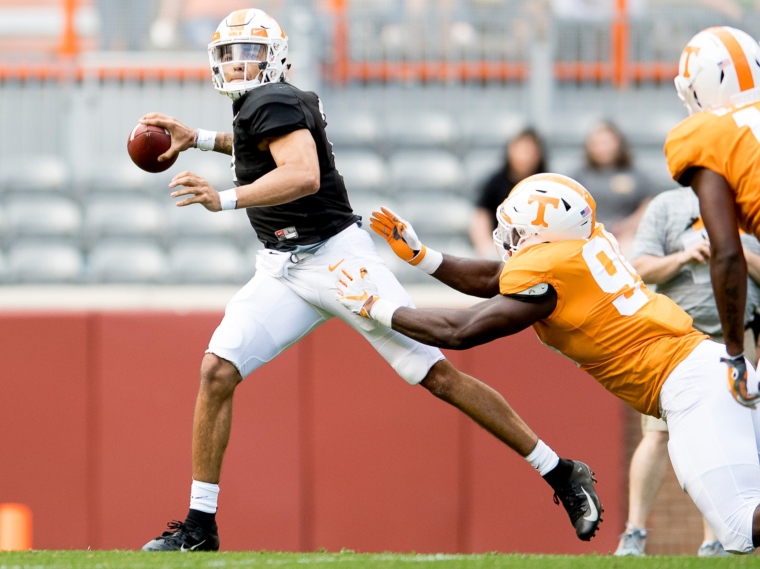 Tennessee quarterback Jarrett Guarantano (2) looks to pass as Tennessee defensive lineman Matthew Butler (94) defends during the Tennessee Spring Game at Neyland Stadium in Knoxville, Tennessee on Saturday, April 13, 2019.
