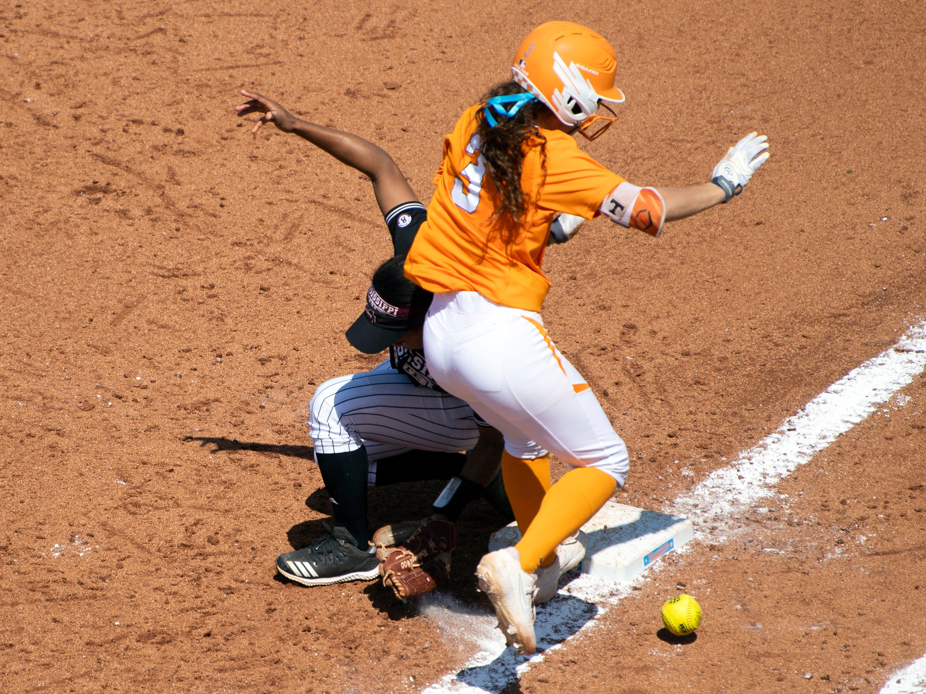 The ballnounces away as Tennessee's Kaitlin Parsons (3) gets to first base and then onto third with on a bunt play that resulted in two runs for Tennessee in the game against Mississippi State on Sunday, April 14, 2019.