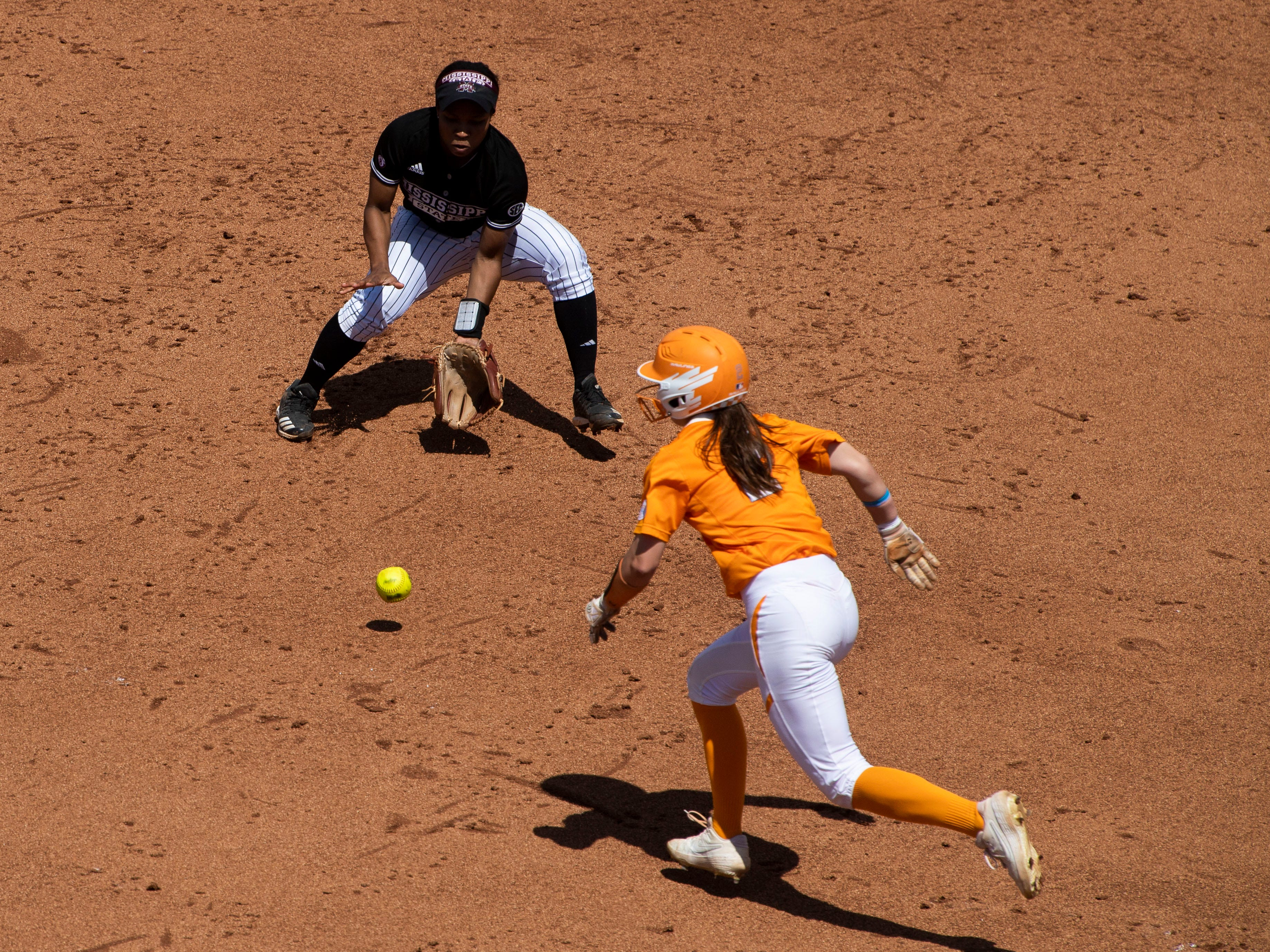 Tennessee's Jenna Holcomb (2) runs to second a a ground ball is hit to Mississippi State's Bevia Robinson (00) in the third game of the series at Sherri Parker Lee Stadium on Sunday, April 14, 2019.