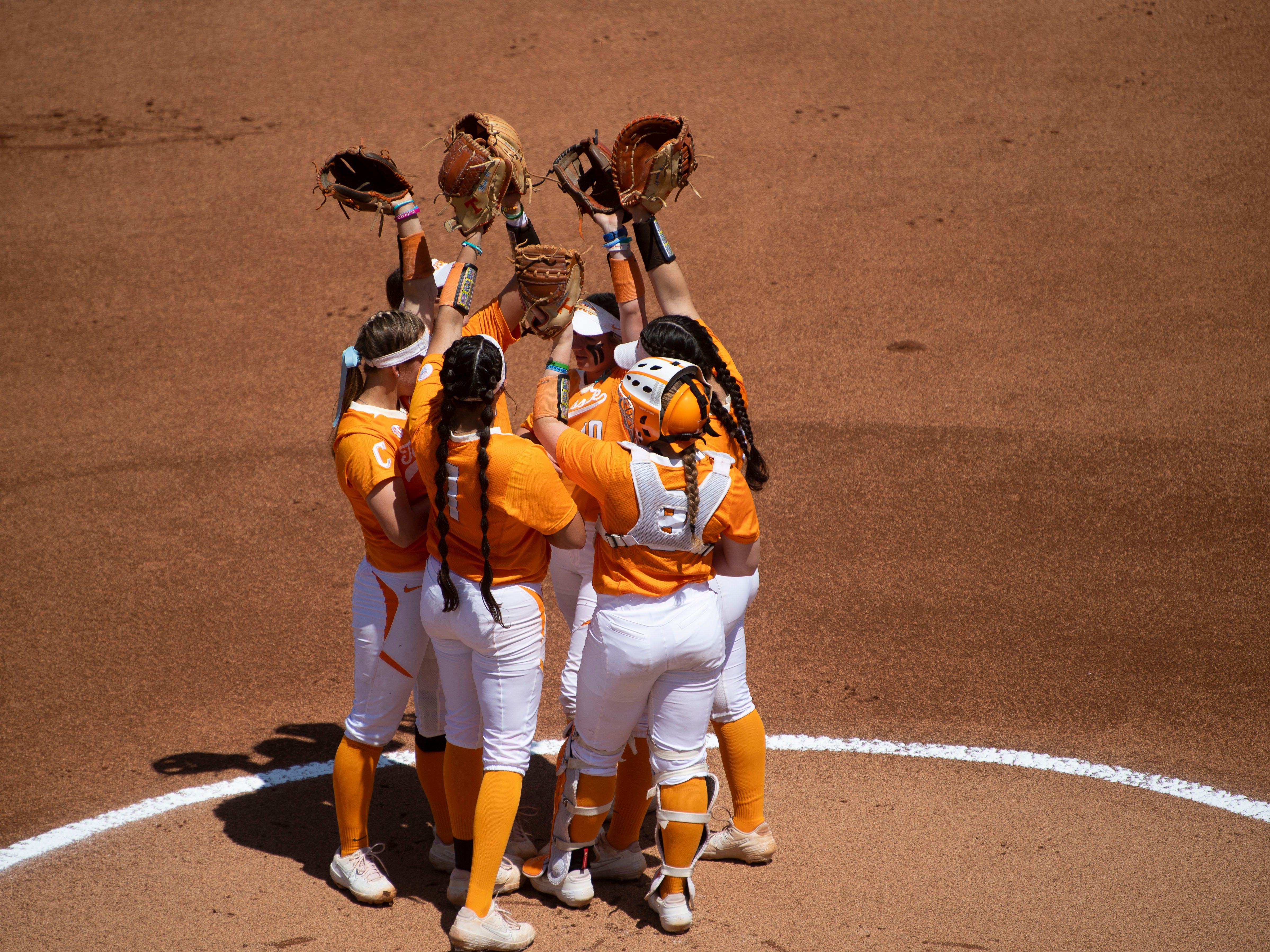 The Tennessee infield gather before the start of their game against Mississippi State at Sherri Parker Lee Stadium on Sunday, April 14, 2019.