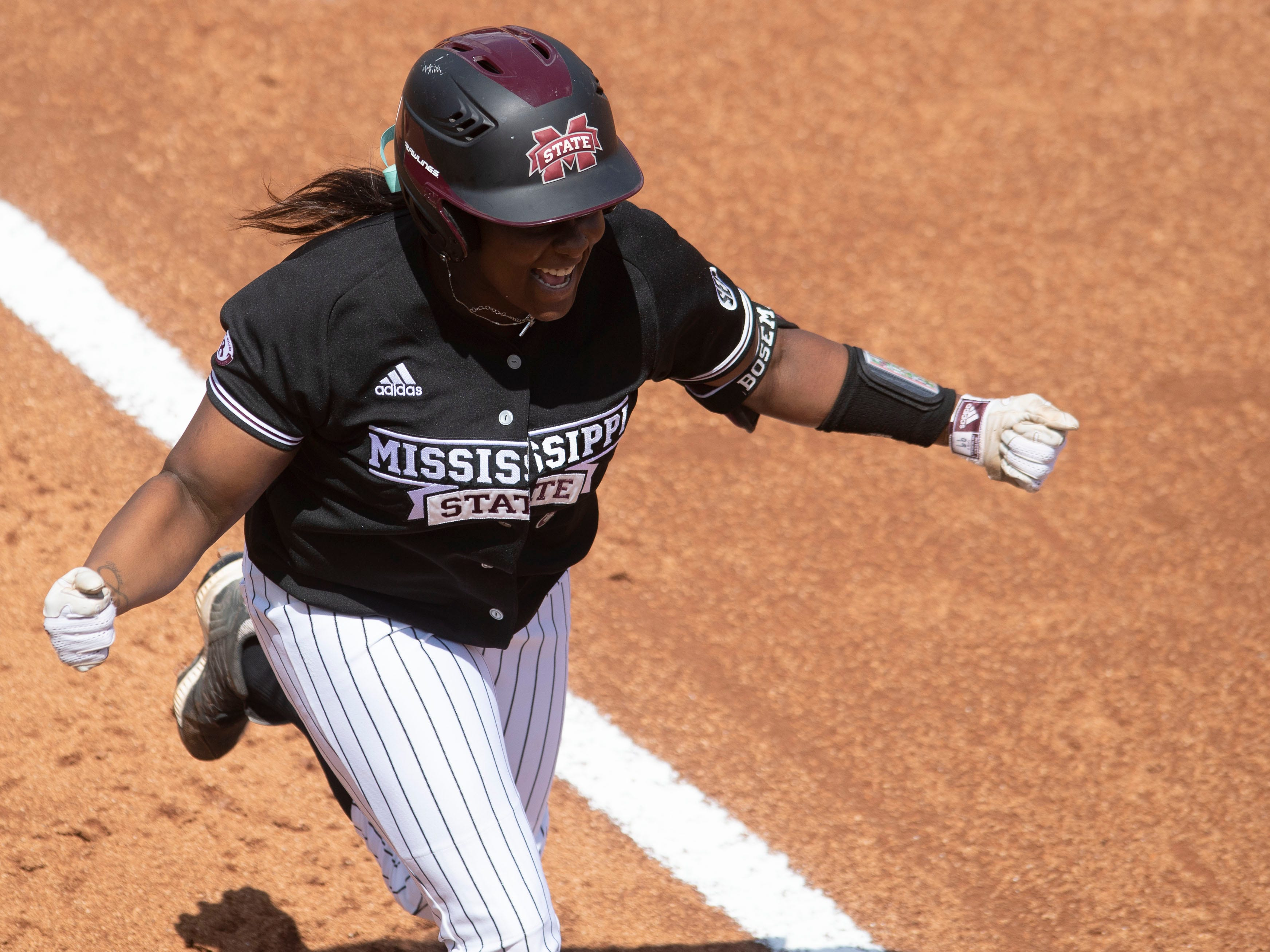Mississippi State's Kayla Boseman (99) rounds the bases on a home run hit in the third game of the series against Tennessee at Sherri Parker Lee Stadium on Sunday, April 14, 2019.