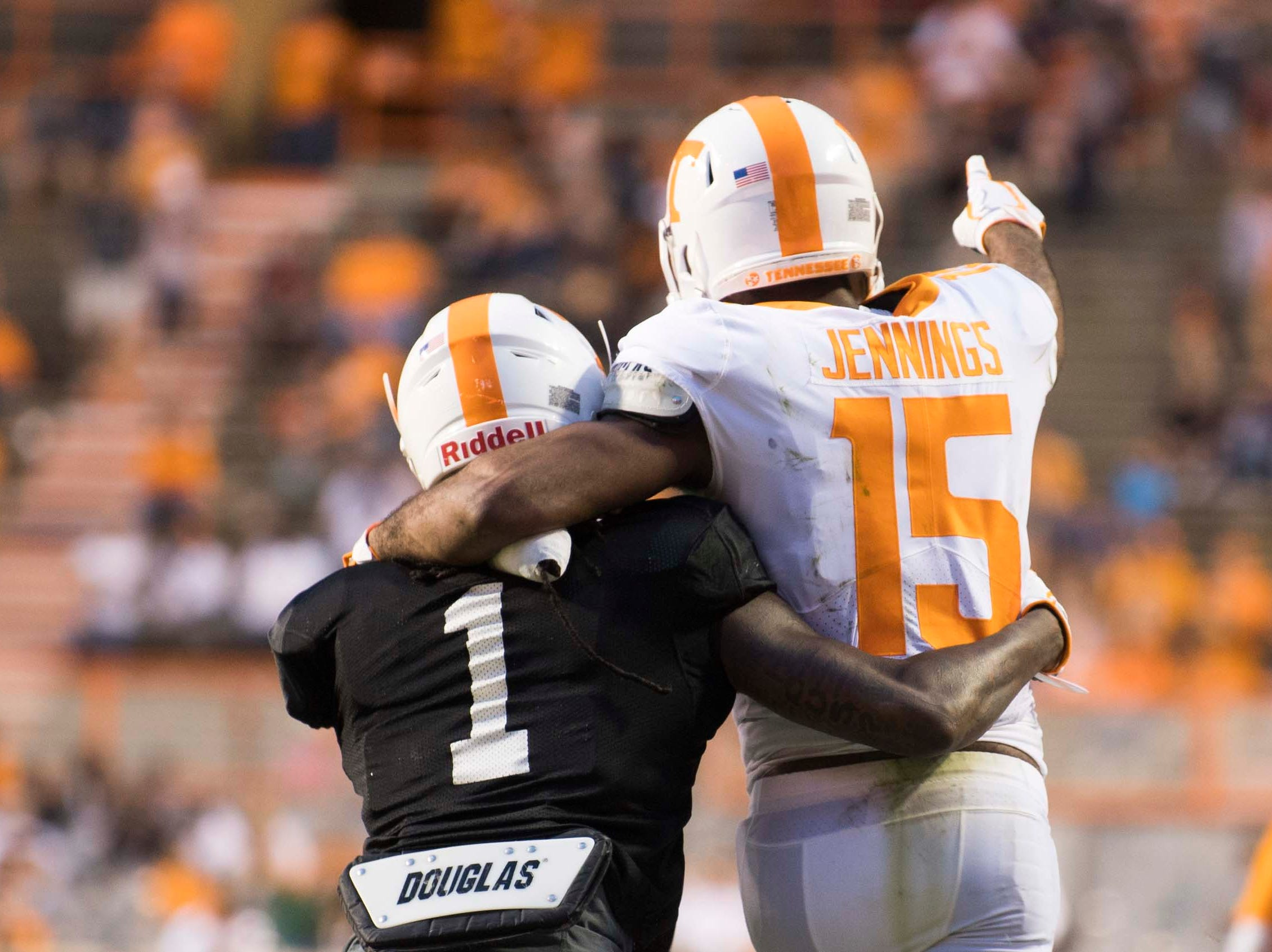 Tennessee wide receiver Marquez Callaway (1) celebrates Tennessee wide receiver Jauan Jennings' (15) touchdown during the Vols spring game in Neyland Stadium in Knoxville Saturday, April 13, 2019.