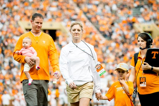 Tennessee Lady Vols basketball head coach Kellie Harper is introduced with her family – her daughter, Kiley, 1; husband, Jon; and son, Jackson, 5 – during the Tennessee spring game at Neyland Stadium in Knoxville, Tennessee on Saturday, April 13, 2019.