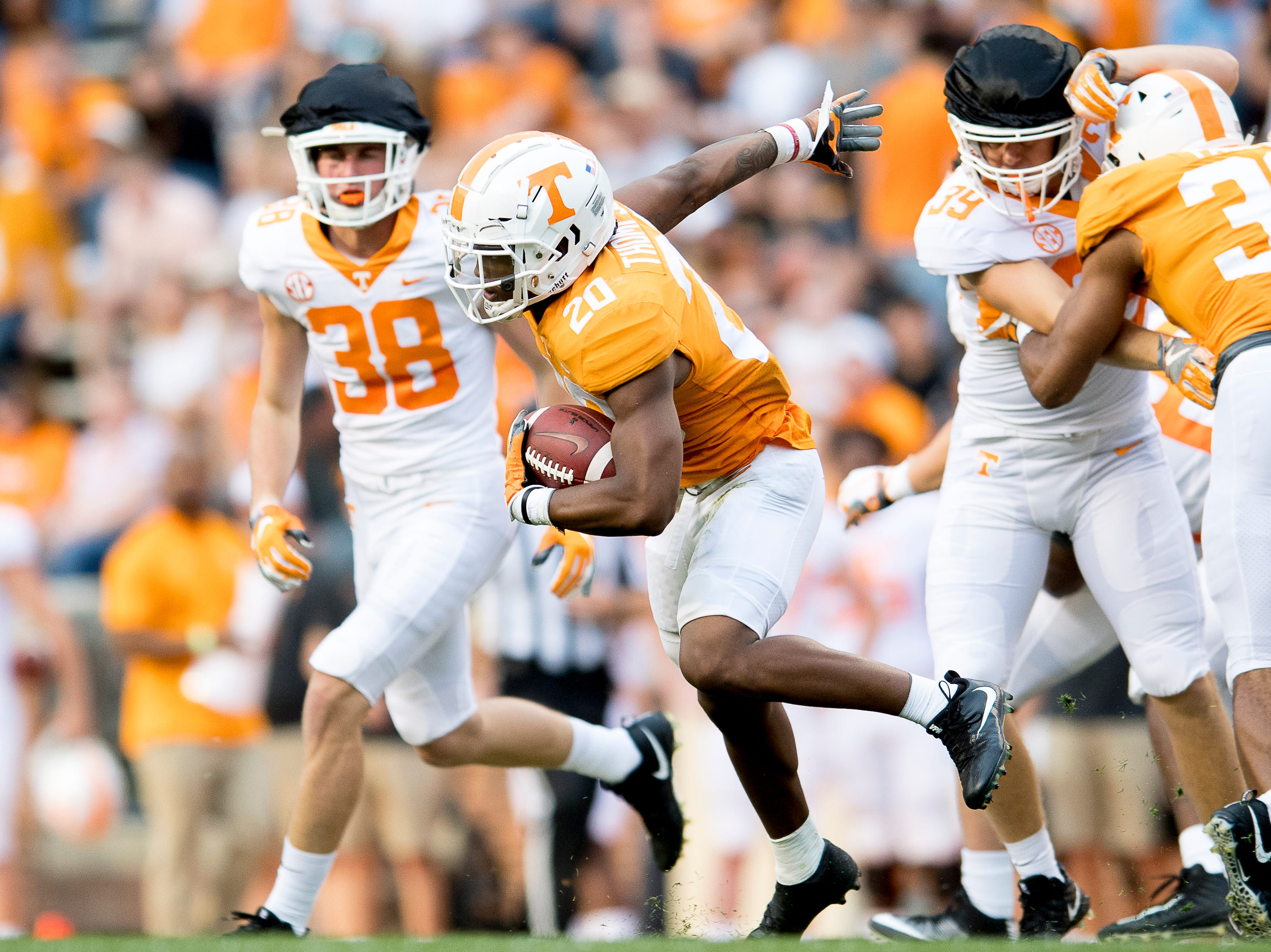 Tennessee defensive back Bryce Thompson (20) dodges the defense during the Tennessee Spring Game at Neyland Stadium in Knoxville, Tennessee on Saturday, April 13, 2019.