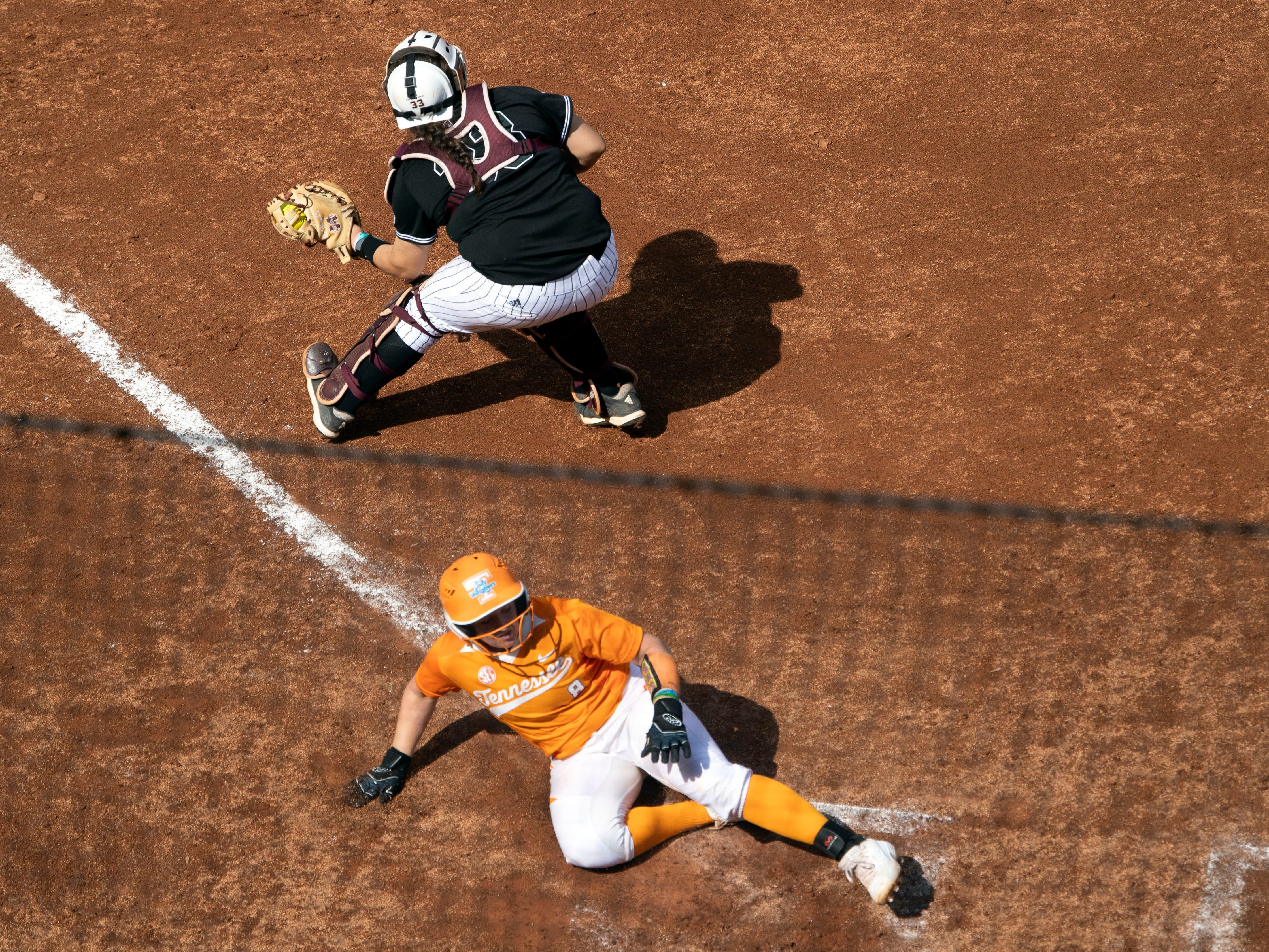 Tennessee's Kaili Phillips (8) slides home for the run against Mississippi State at Sherri Parker Lee Stadium on Sunday, April 14, 2019.