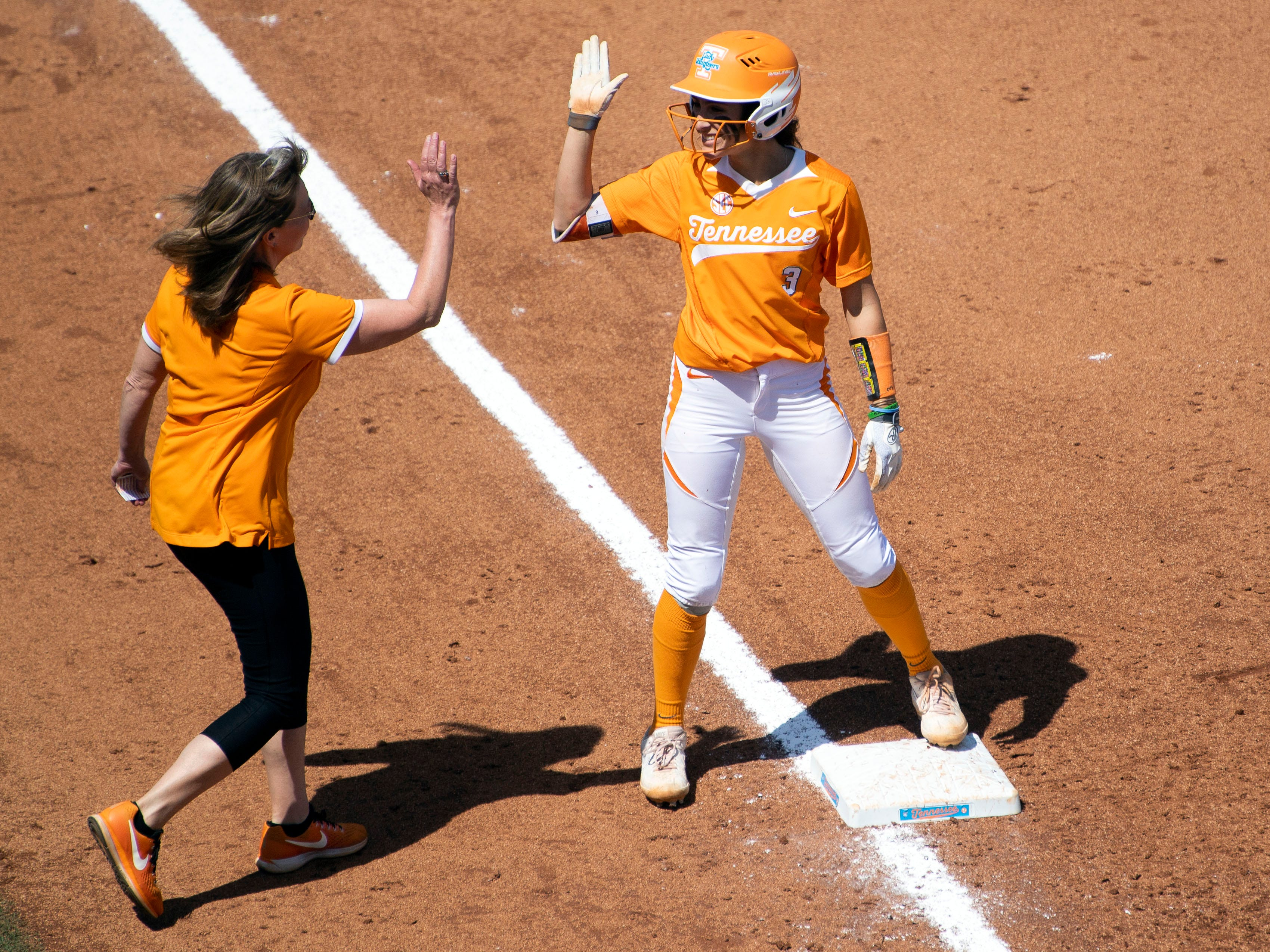 Tennessee's Kaitlin Parsons (3) is congratulated by co-head coach Karen Weekly after Parson's bunt resulted in a triple and two runs for Tennessee in the game against Mississippi State at Sherri Parker Lee Stadium on Sunday, April 14, 2019.