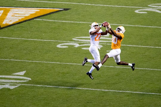 Tennessee defensive back Jaylen McCollough (22) and Tennessee wide receiver Ramel Keyton (80) go for a catch during the Tennessee Spring Game at Neyland Stadium in Knoxville, Tennessee on Saturday, April 13, 2019.