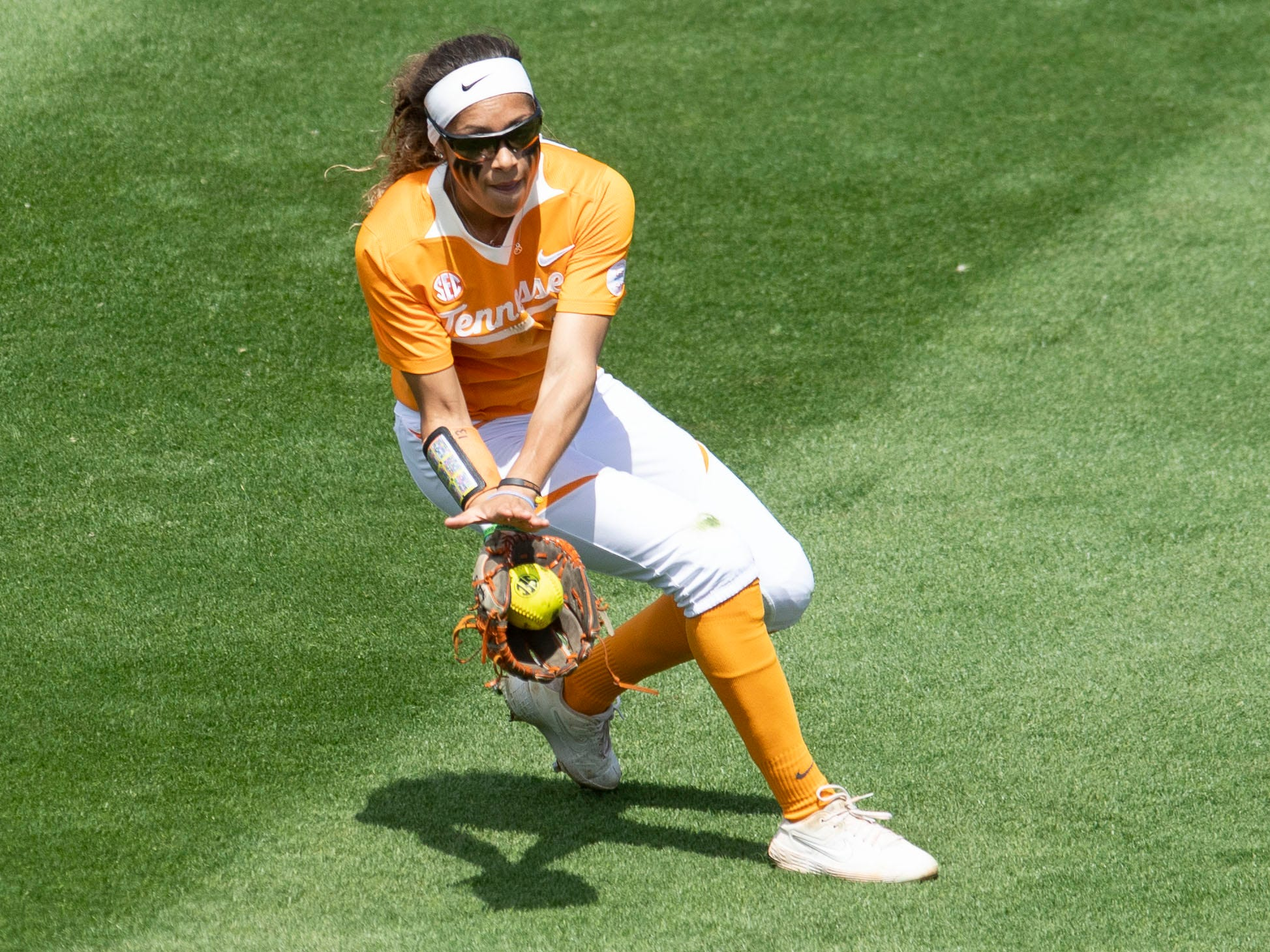 Tennessee's Amanda Ayala (13) stops a ball in outfield in the game against Mississippi State at Sherri Parker Lee Stadium on Sunday, April 14, 2019.