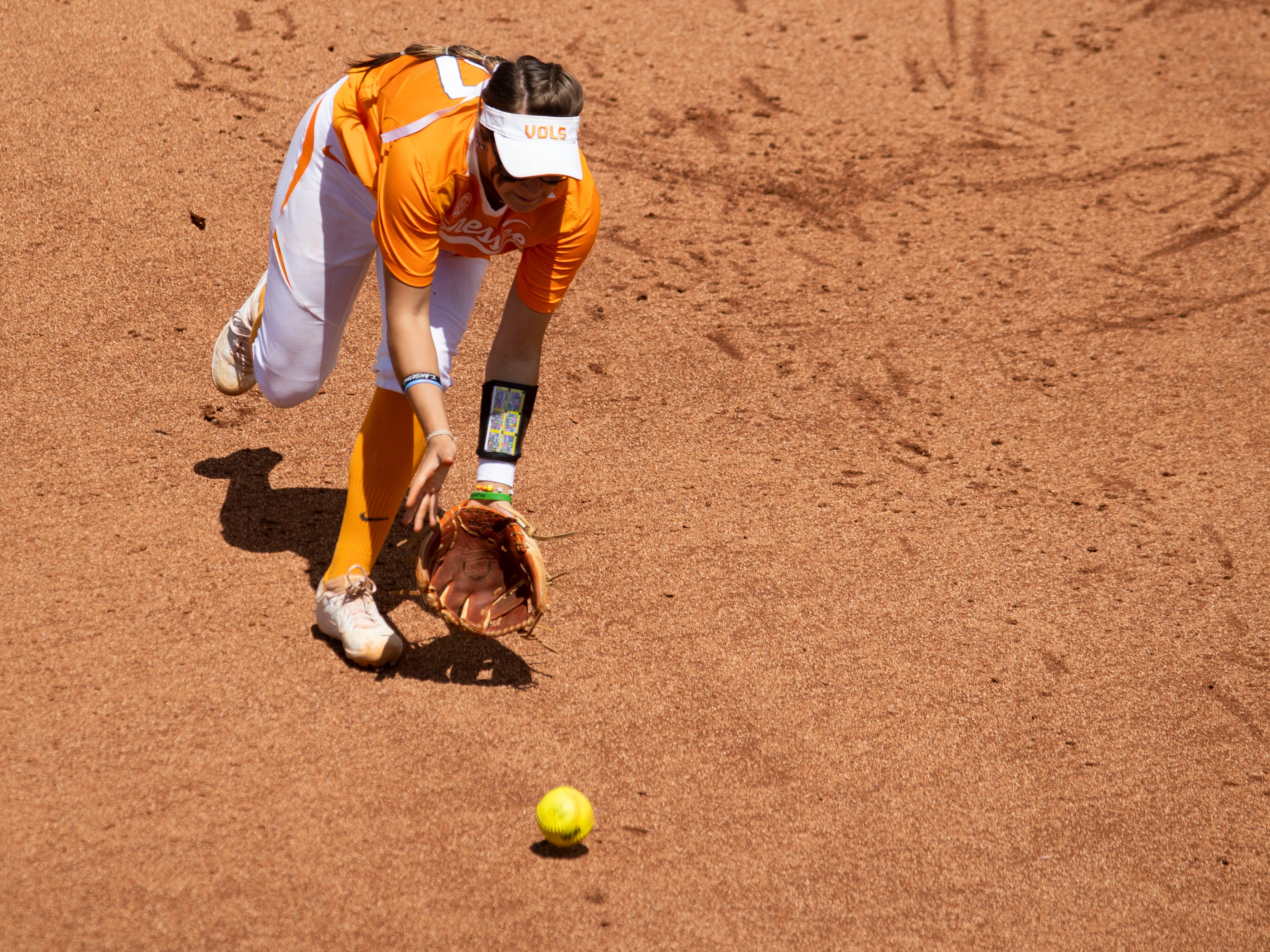 Tennessee's Gracie Osbron (77) gets in front of a ground ball in the game third game against Mississippi State at Sherri Parker Lee Stadium on Sunday, April 14, 2019.