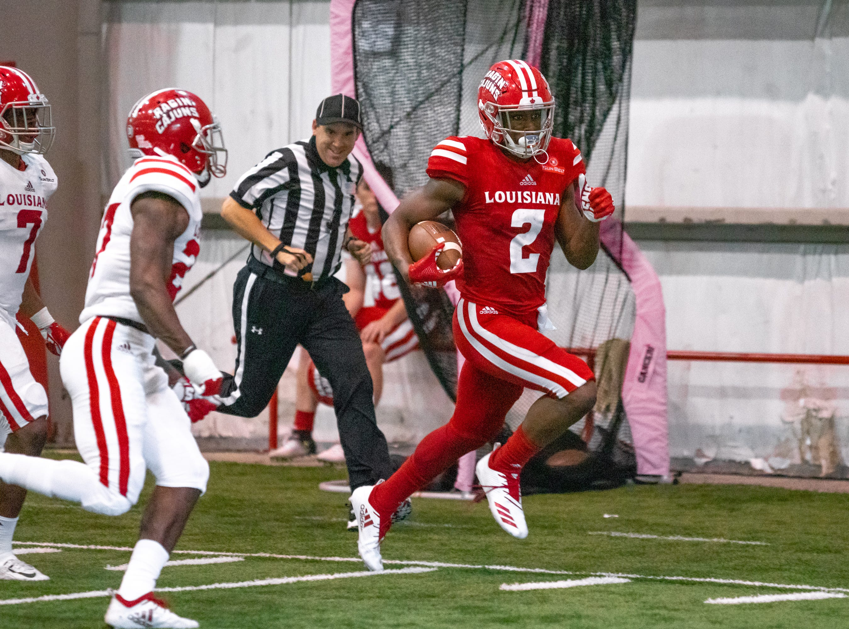 UL's Ja'Marcus Bradley runs the ball along the sidelines and towards the endzone as the Ragin' Cajuns football team plays their annual Spring football game against one another in the Leon Moncla trainig facility on April 13, 2019.
