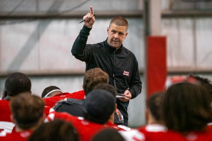 UL's head coach Billy Napier talks to his players after the game as the Ragin' Cajuns football team plays their annual Spring football game against one another in the Leon Moncla trainig facility on April 13, 2019.