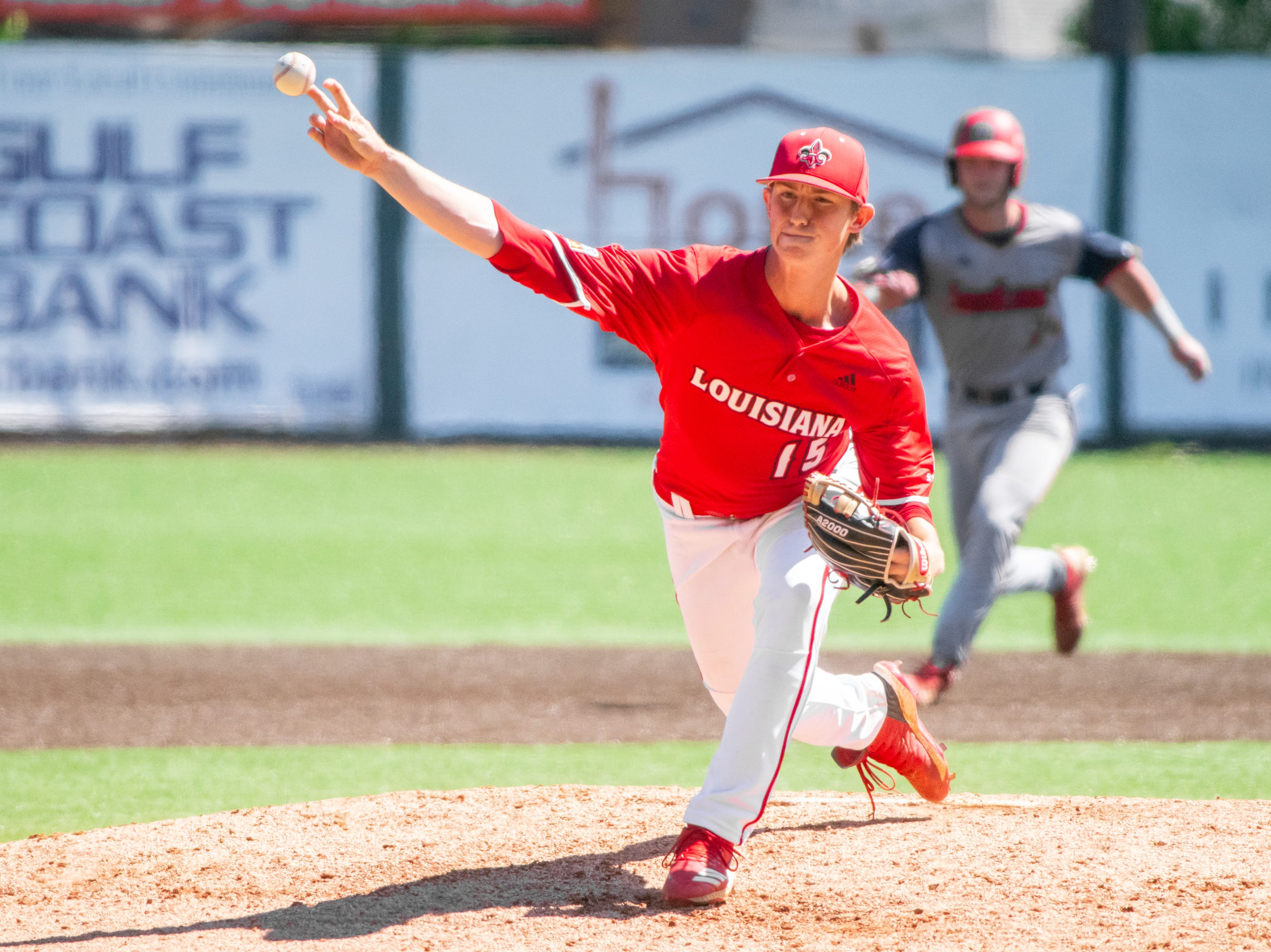 """UL's Jacob Schultz throws a pitch from the mound as the Ragin' Cajuns take on the South Alabama Jaguars at M.L. """"Tigue"""" Moore Field on Sunday, April 14, 2019."""