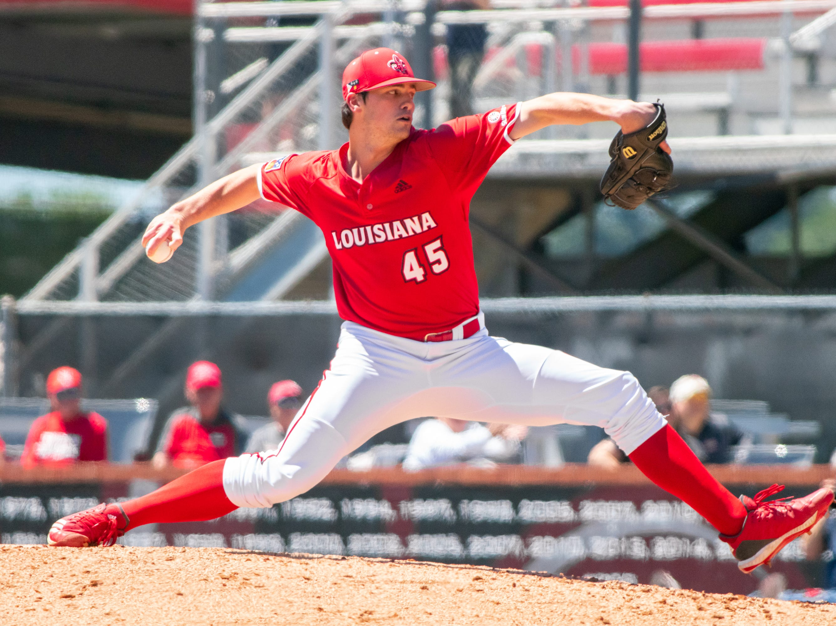 """UL's pitcher Jack Burk throws from the mound as the Ragin' Cajuns take on the South Alabama Jaguars at M.L. """"Tigue"""" Moore Field on Sunday, April 14, 2019."""