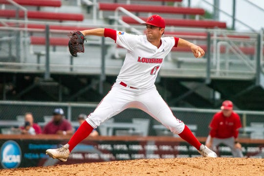 """UL's Gunner Leger winds up a throw from the mound as the Ragin' Cajuns take on the South Alabama Jaguars at M.L. """"Tigue"""" Moore Field on Saturday, April 13, 2019."""
