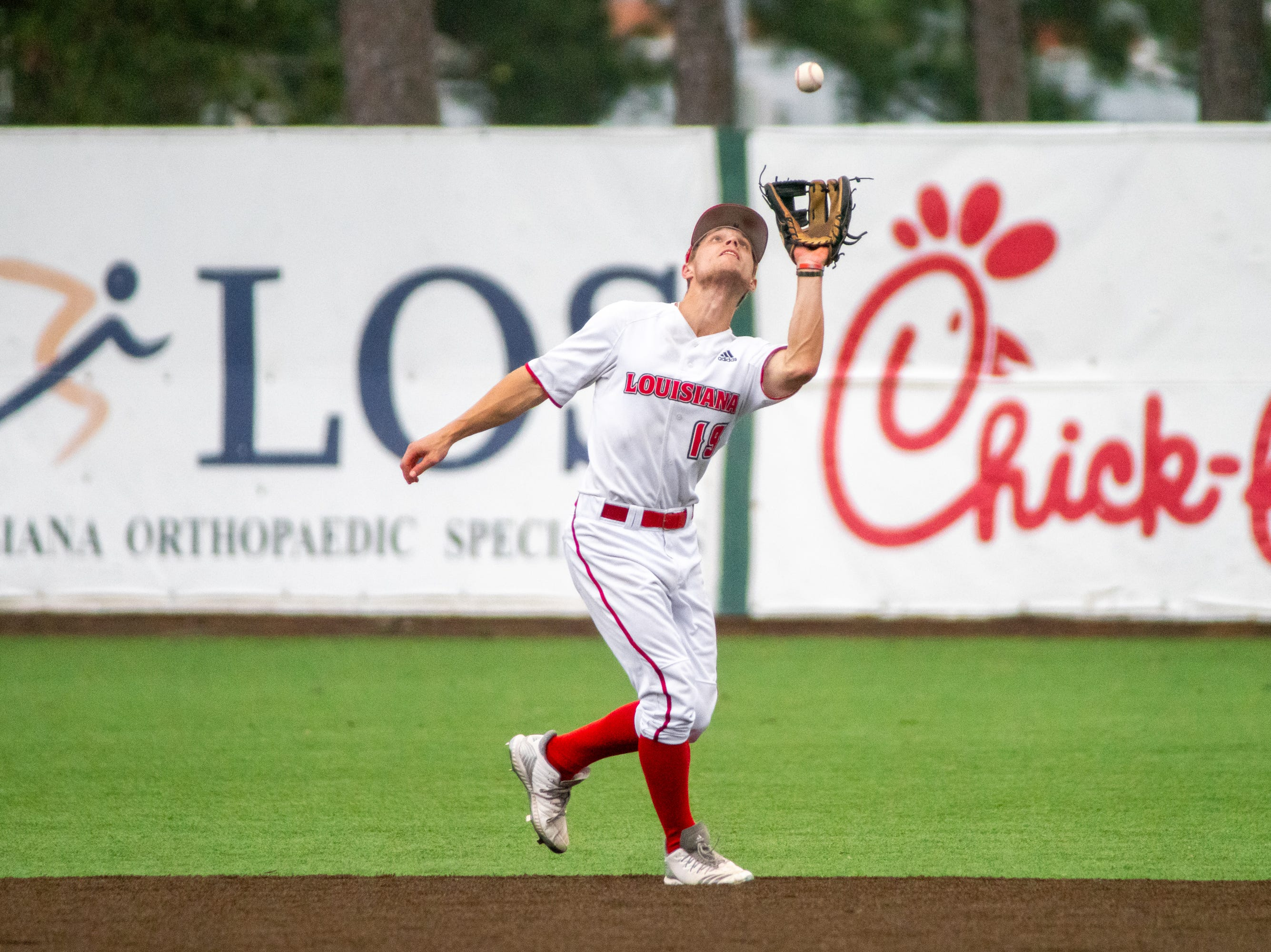 """UL's Hunter Kasuls makes a catch in the infield as the Ragin' Cajuns take on the South Alabama Jaguars at M.L. """"Tigue"""" Moore Field on Saturday, April 13, 2019."""