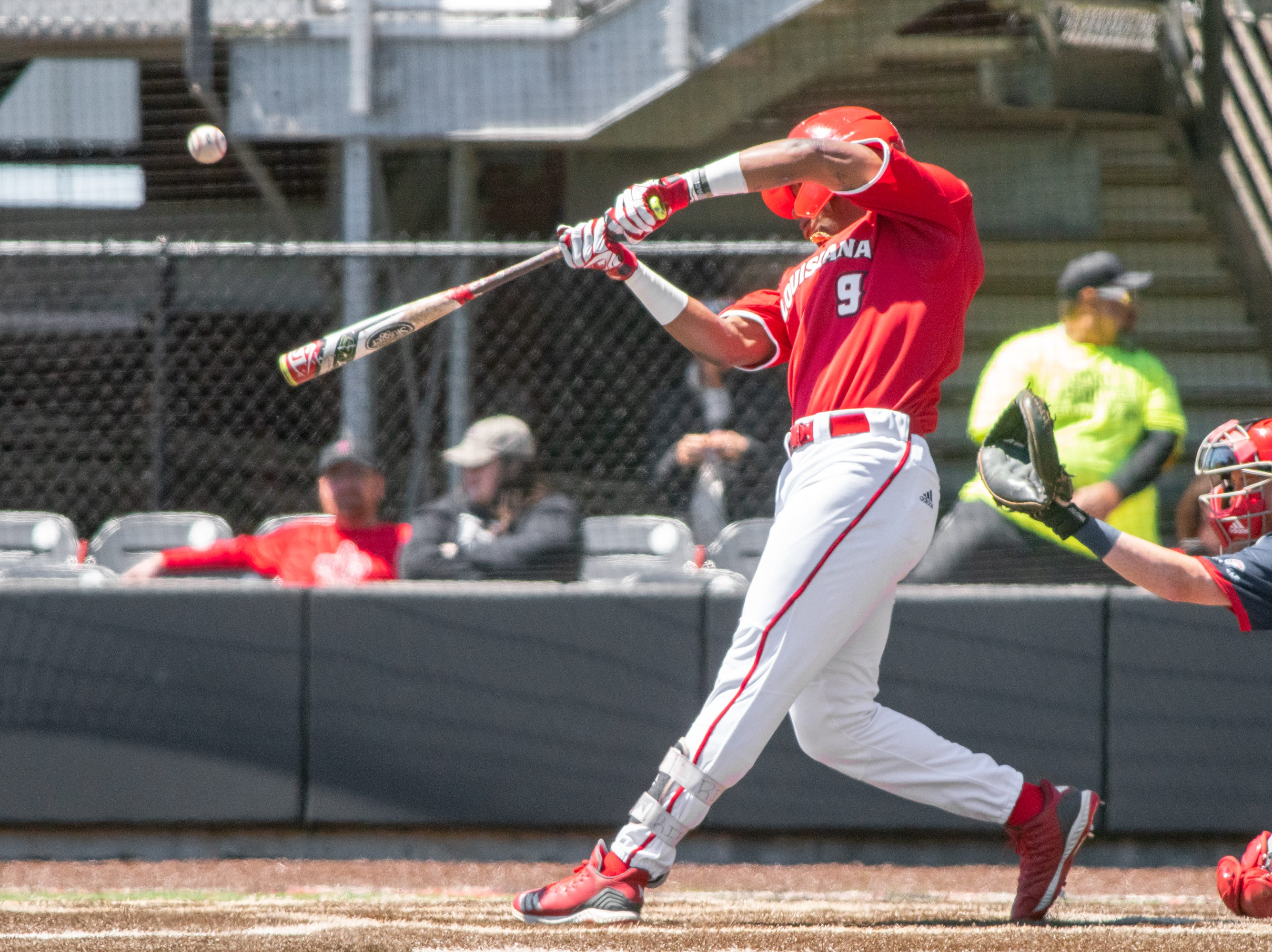 """UL's Todd Lott hits the pitch and scores a solo homerun as the Ragin' Cajuns take on the South Alabama Jaguars at M.L. """"Tigue"""" Moore Field on Sunday, April 14, 2019."""