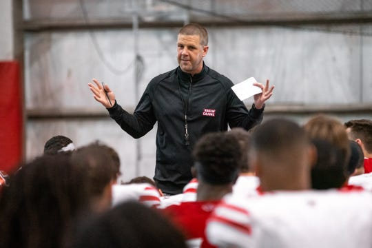 UL coach Billy Napier talks to his team after its spring game in April.