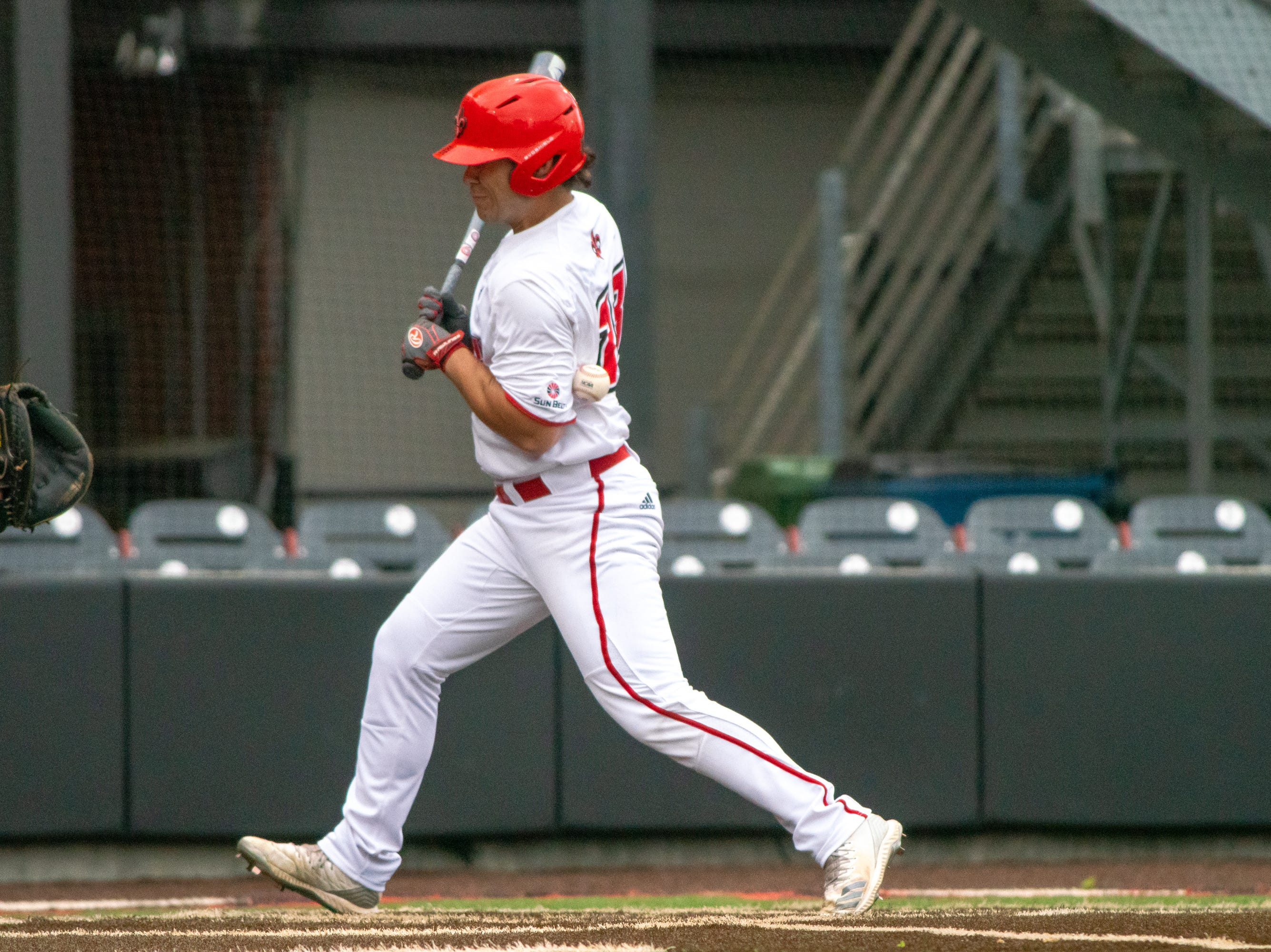 """UL's Handsome Monica gets hit by the pitch as the Ragin' Cajuns take on the South Alabama Jaguars at M.L. """"Tigue"""" Moore Field on Saturday, April 13, 2019."""