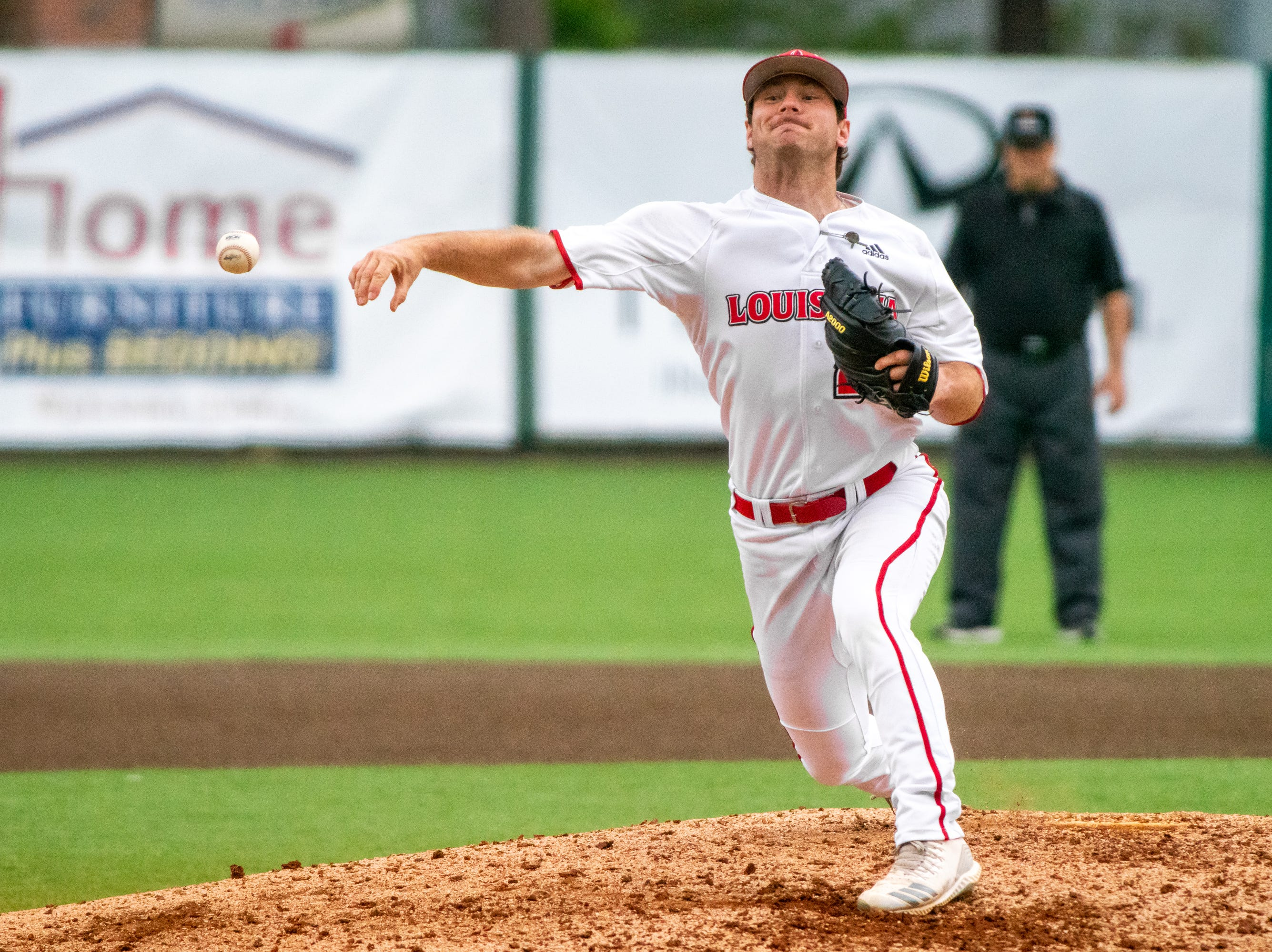 """UL's Caleb Armstrong throws out a pitch from the mound as the Ragin' Cajuns take on the South Alabama Jaguars at M.L. """"Tigue"""" Moore Field on Saturday, April 13, 2019."""