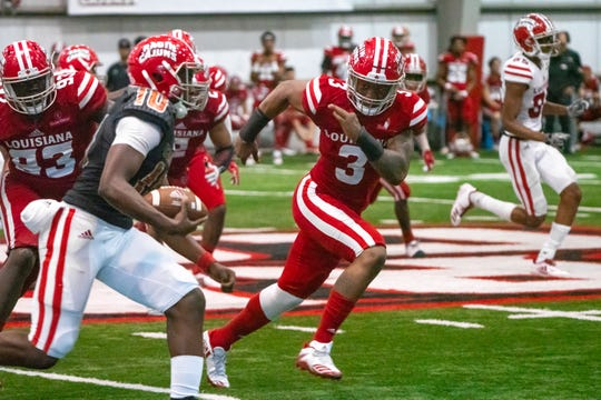 UL's Joe Dillon chases after the ball during the play as the Ragin' Cajuns football team plays their annual Spring football game against one another in the Leon Moncla trainig facility on April 13, 2019.