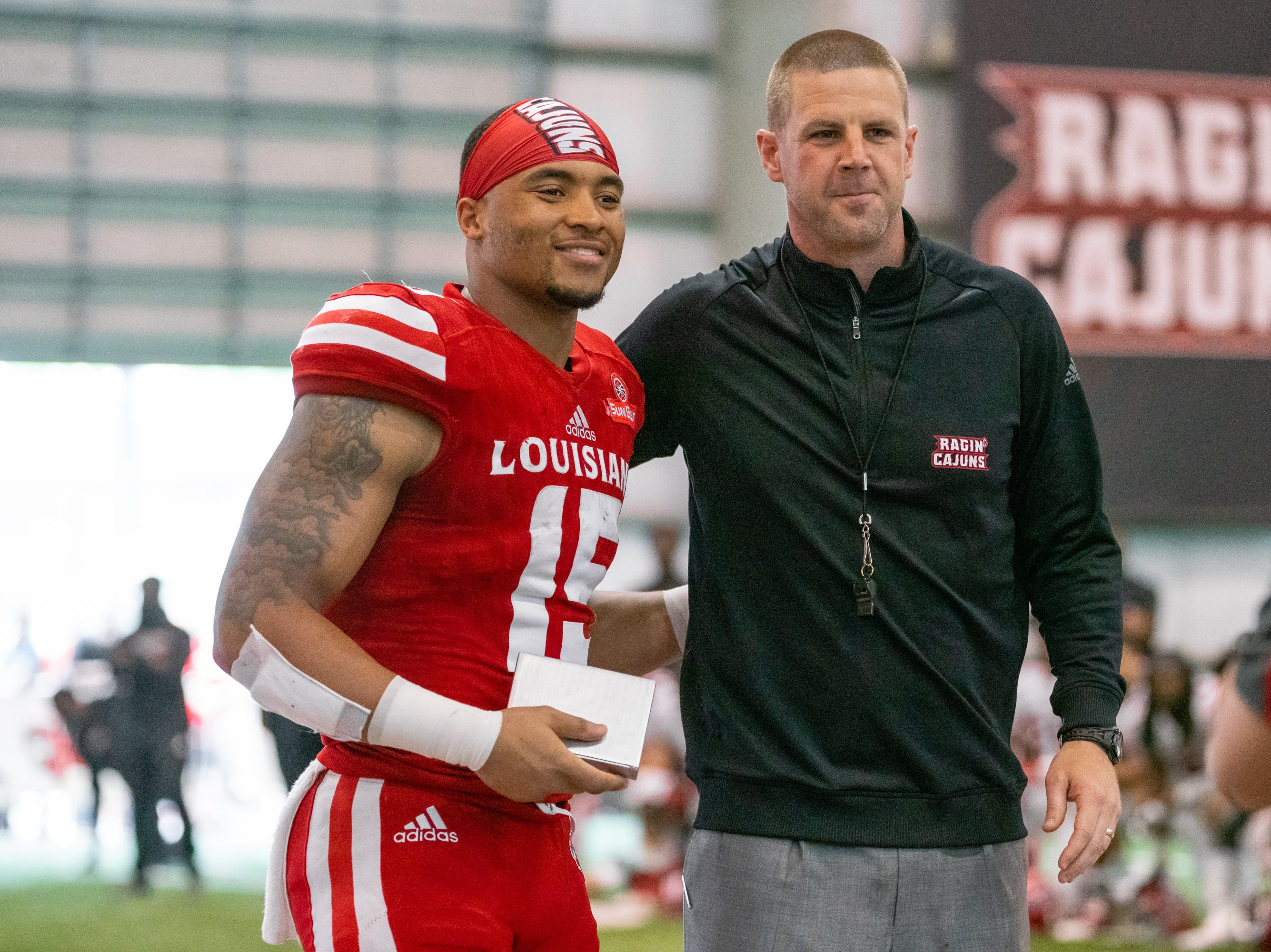 UL's head coach Billy Napier poses with Elijah Mitchell during halftime as the Ragin' Cajuns football team plays their annual Spring football game against one another in the Leon Moncla trainig facility on April 13, 2019.